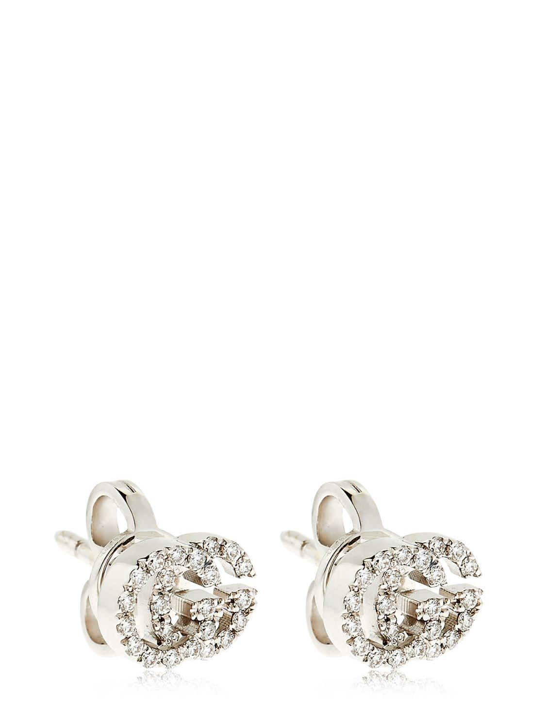 0acd5cd2cc3 Lyst - Gucci Running G Diamond Stud Earrings in White
