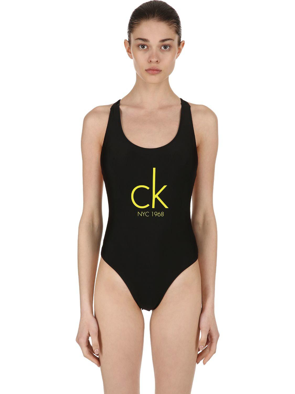 b9122bb6262ec Lyst - Calvin Klein Cheeky Racerback One Piece Swimsuit in Black