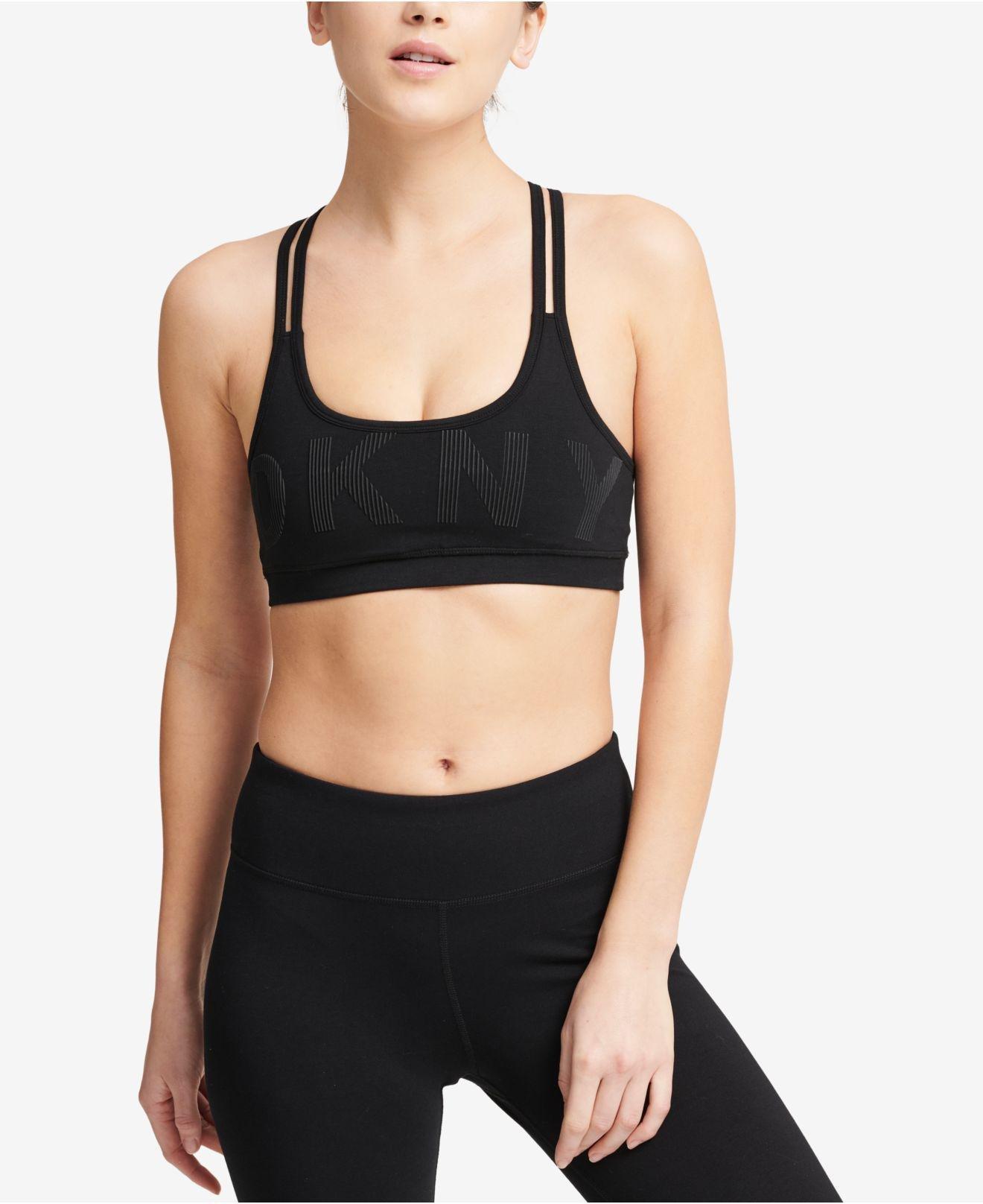 f3ce0050e1 Lyst - DKNY Sport Logo Low-impact Strappy-back Sports Bra in Black