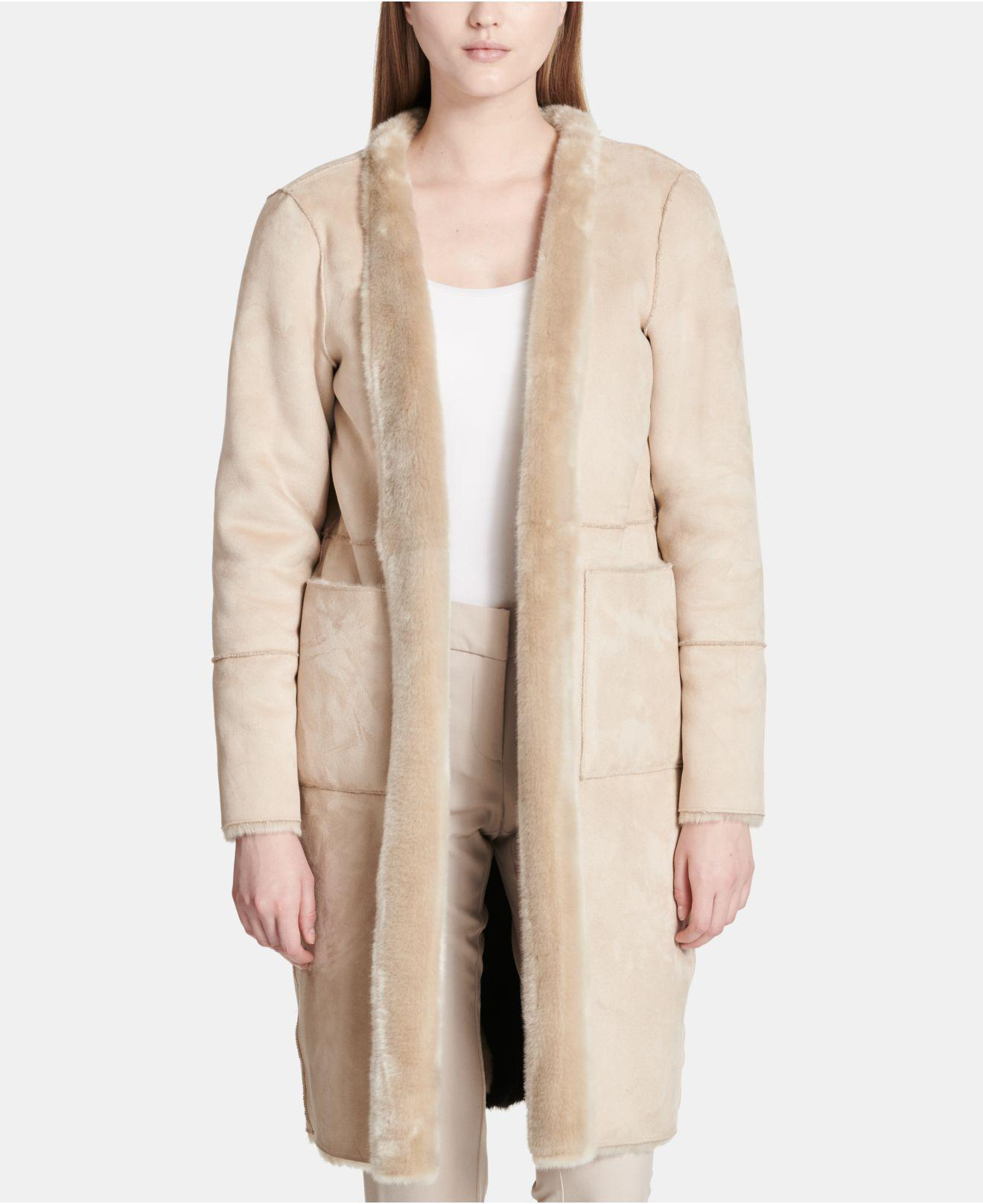 32bc0849bd2f Lyst - Calvin Klein Long Reversible Faux-fur Jacket in Natural