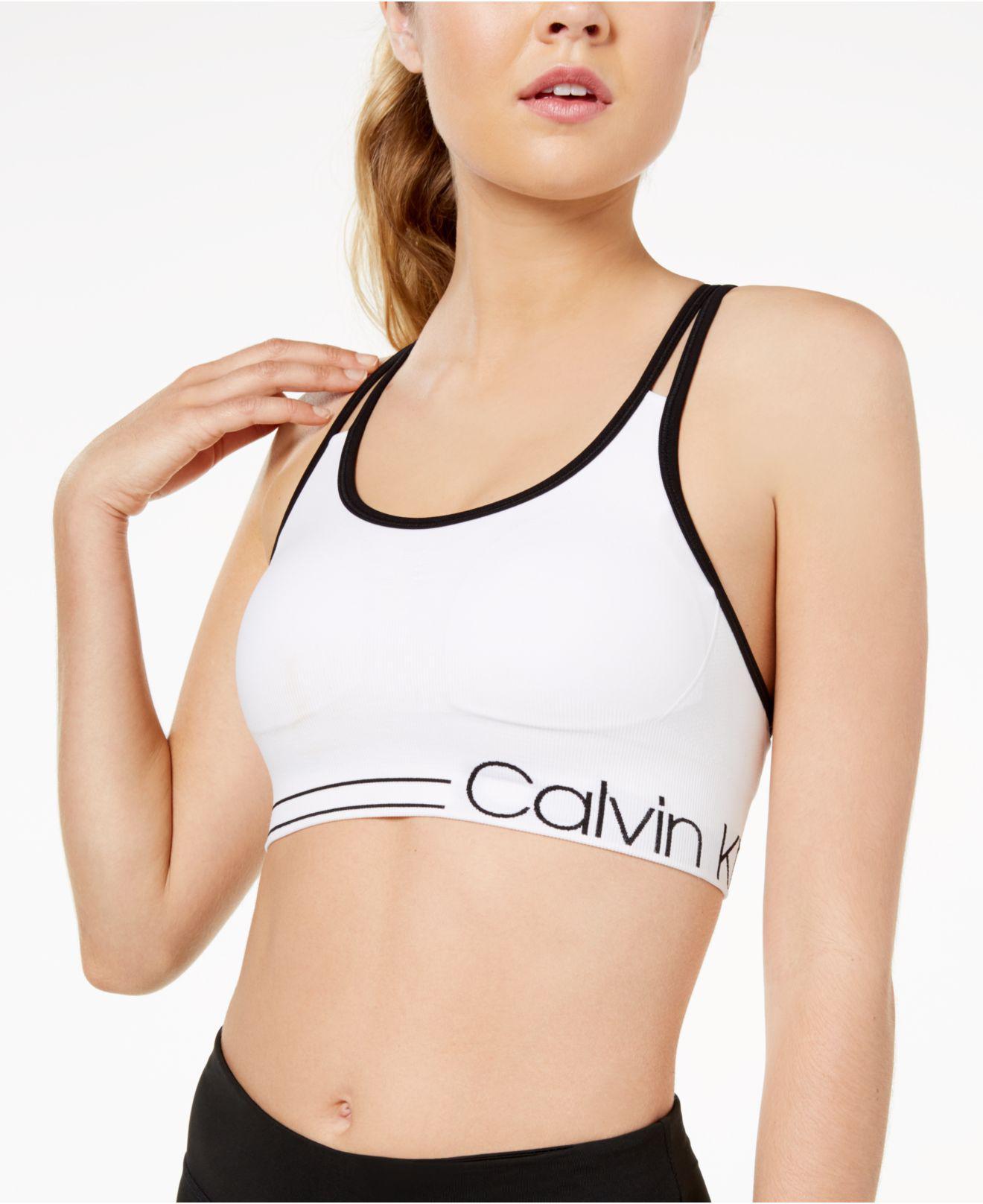 15e8c49422 Lyst - Calvin Klein Performance Piped Sports Bra in White