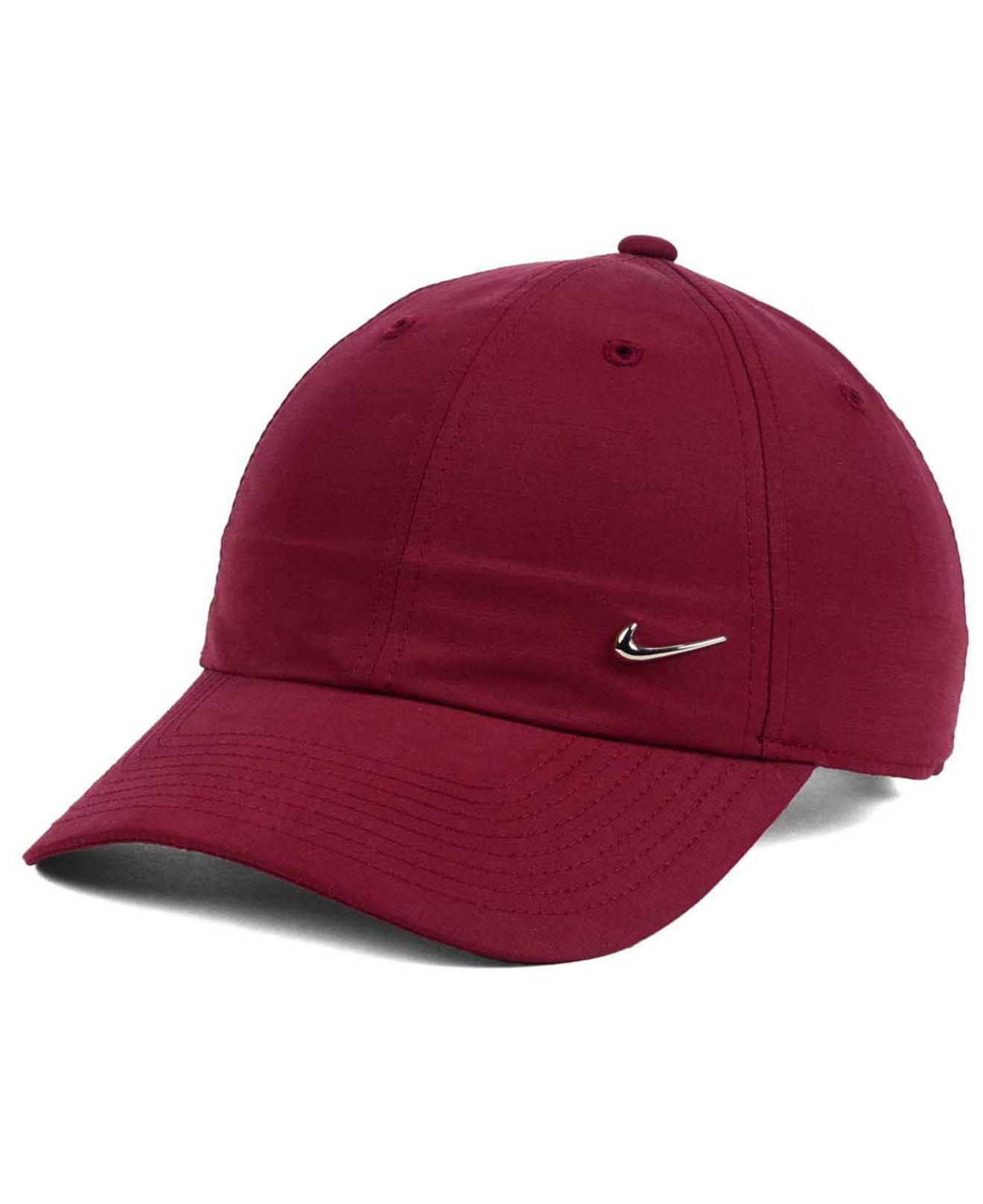 f4dcad9096b ... where to buy lyst nike metal swoosh cap in red for men 723b4 b468e ...