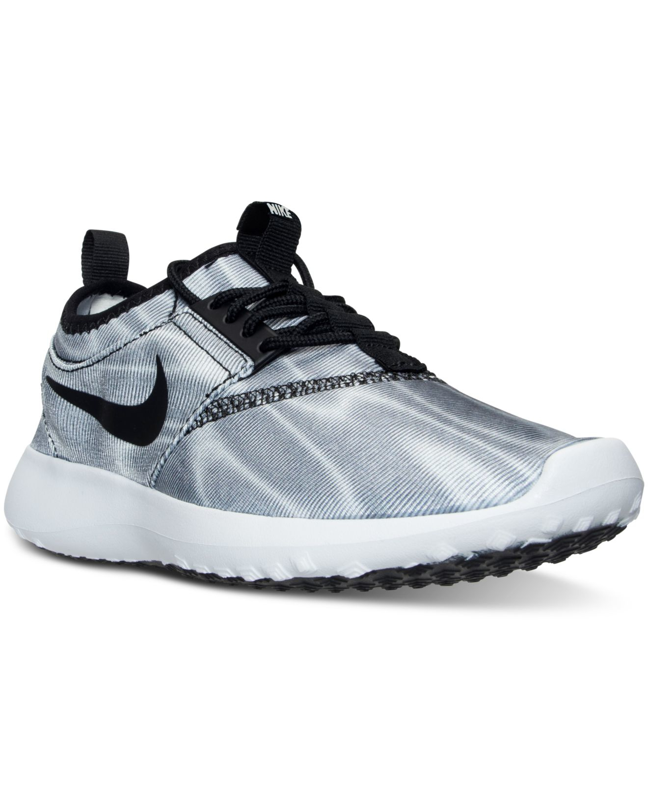 28bd5149ad78a ... where to buy lyst nike womens juvenate print casual sneakers from  finish line b597d c565b