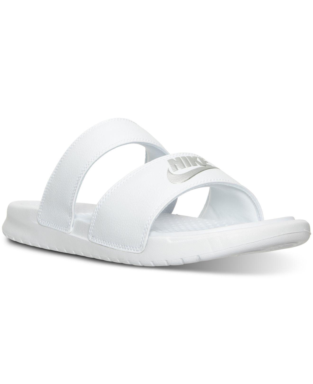 3d7214161 Lyst - Nike Women s Benassi Duo Ultra Slide Sandals From Finish Line ...