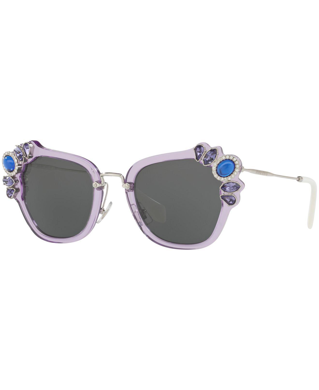 e029ff9a27f Miu Miu. Women s Gray Sunglasses ...