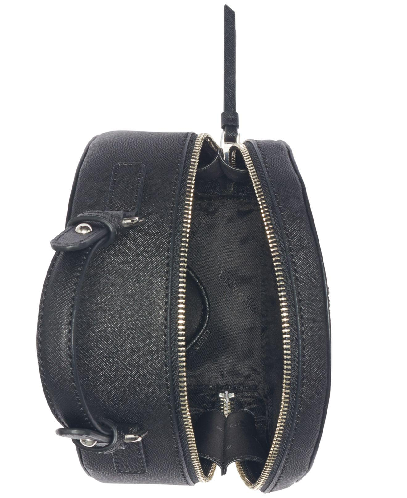 9277ce61cd42 Lyst - Calvin Klein Saffiano Leather Small Novelty Round Cantine Crossbody  in Black