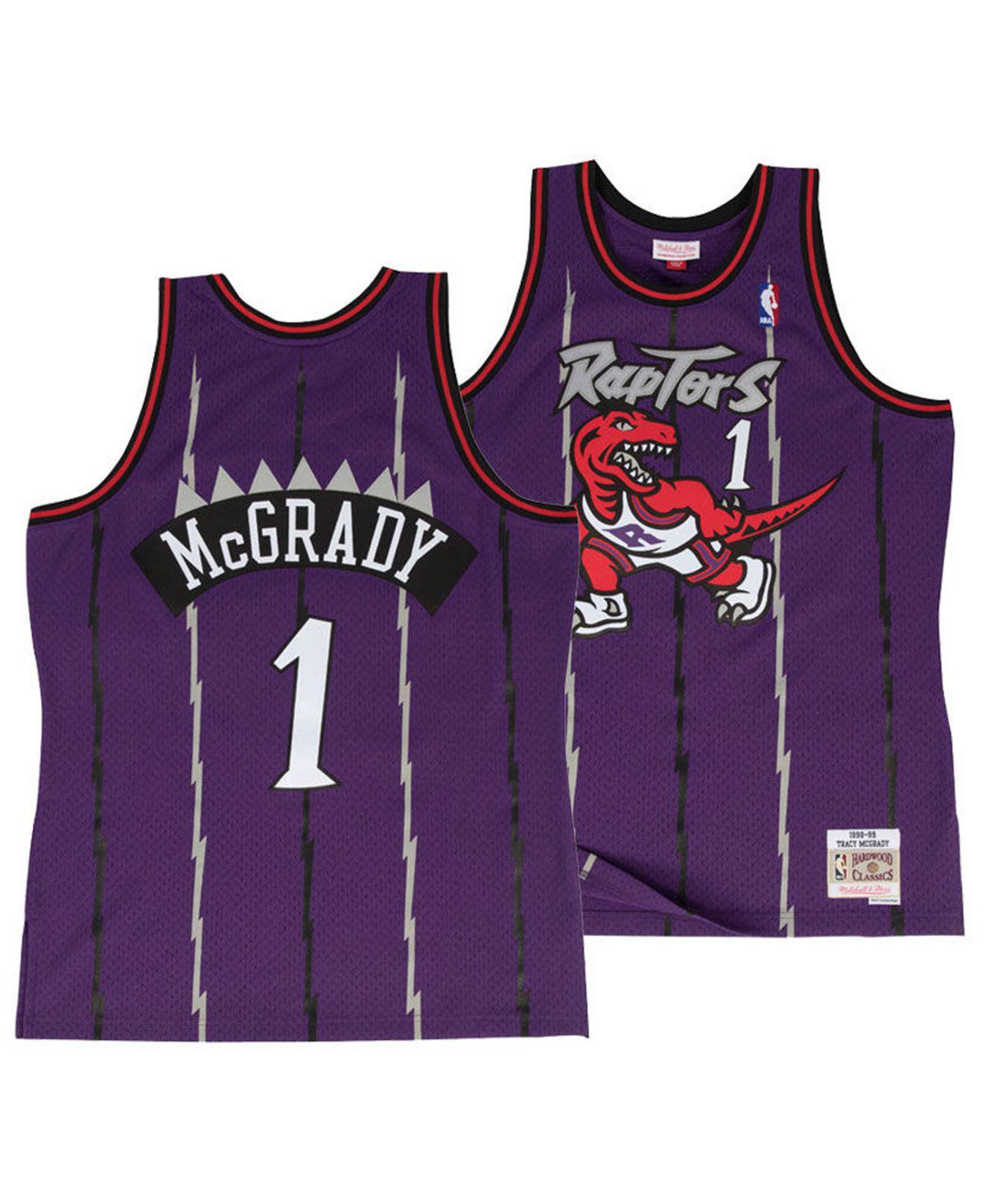 96151fe2d6a7 Mitchell   Ness. Men s Purple Tracy Mcgrady Toronto Raptors Hardwood  Classic Swingman Jersey