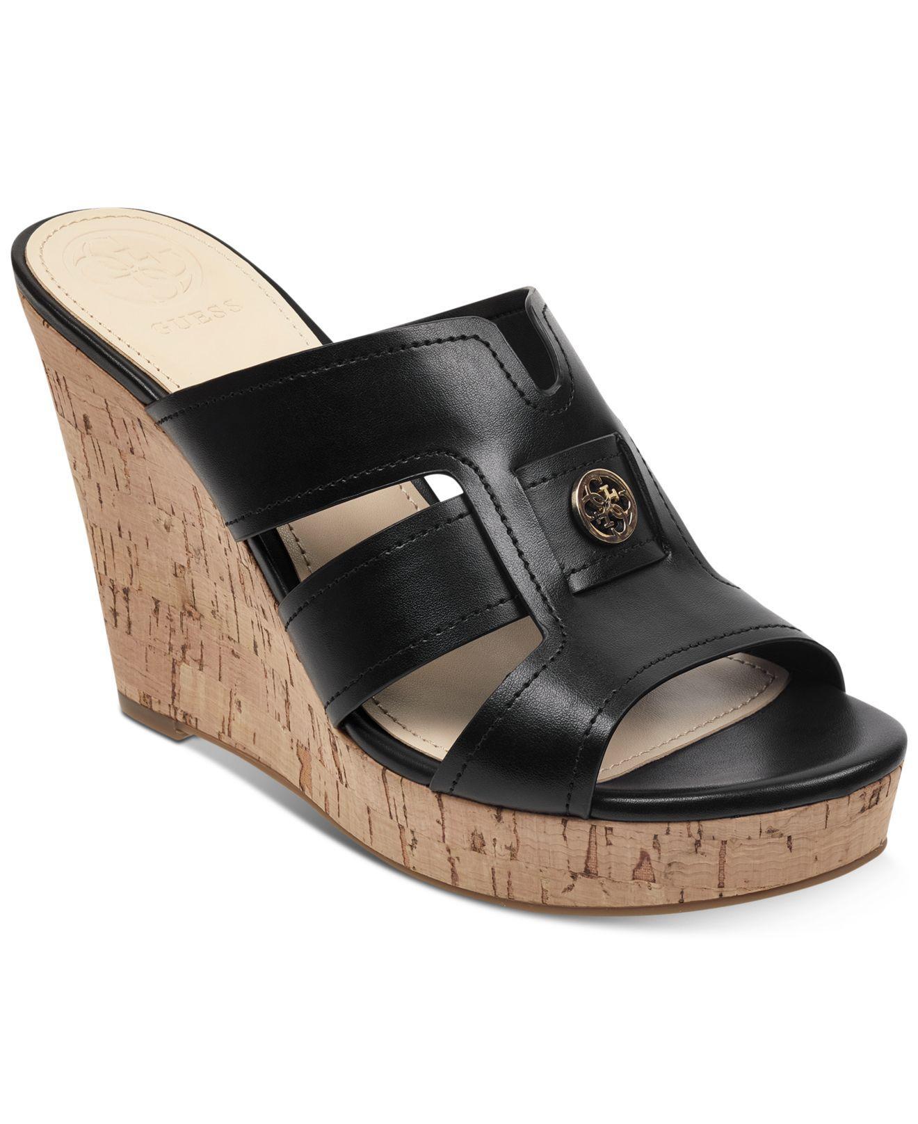 6dec73e12752 Lyst - Guess Eadra Wedge Slide Sandals in Black