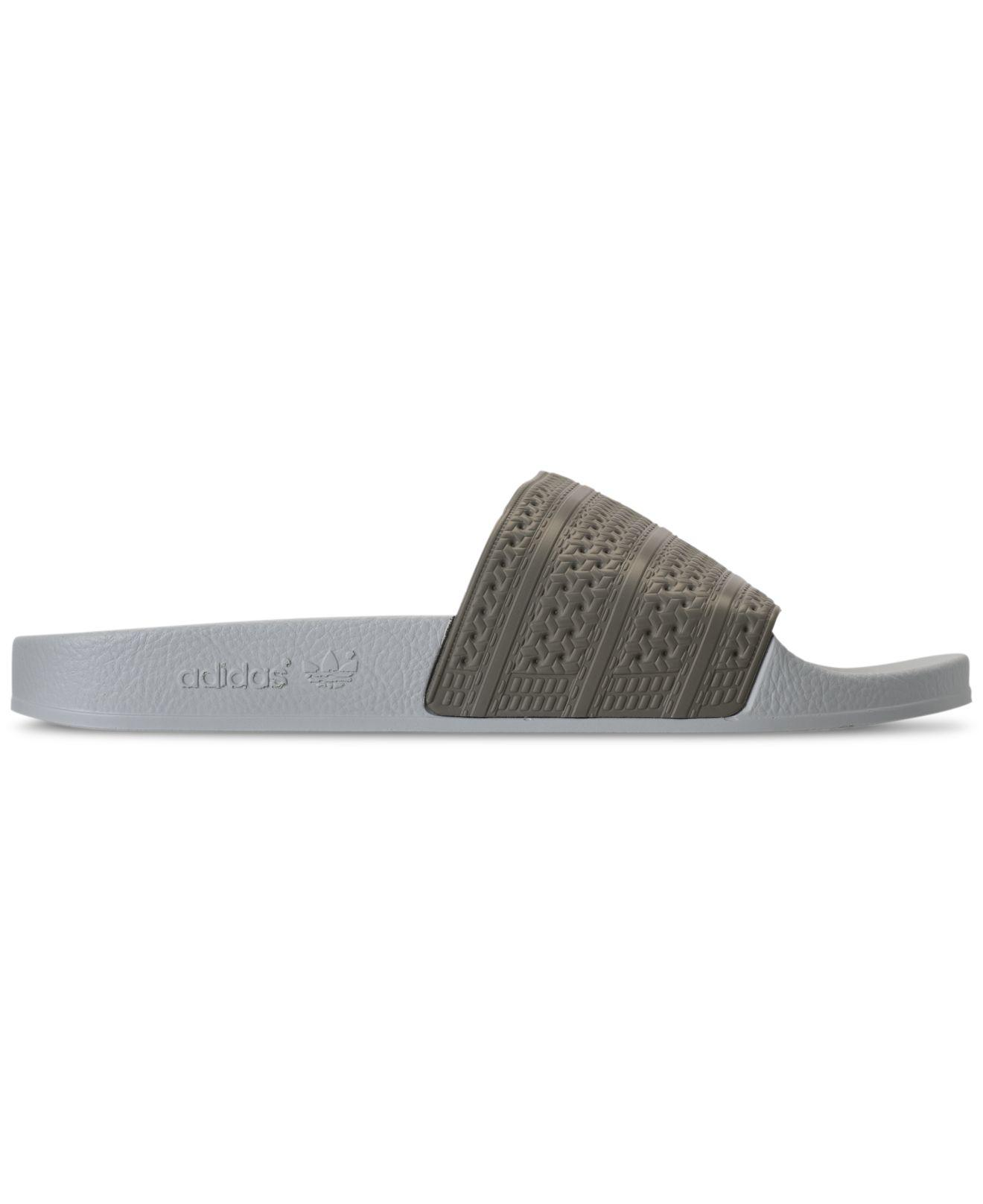 c094a8f7219e90 Lyst - Adidas Men s Adilette Slide Sandals From Finish Line for Men