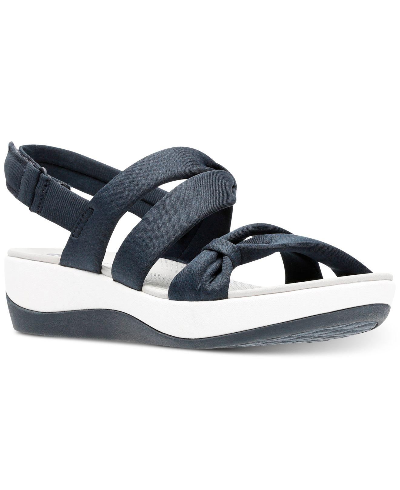9d287862740 Lyst - Clarks Cloudsteppers Arla Mae Wedge Sandals in Blue
