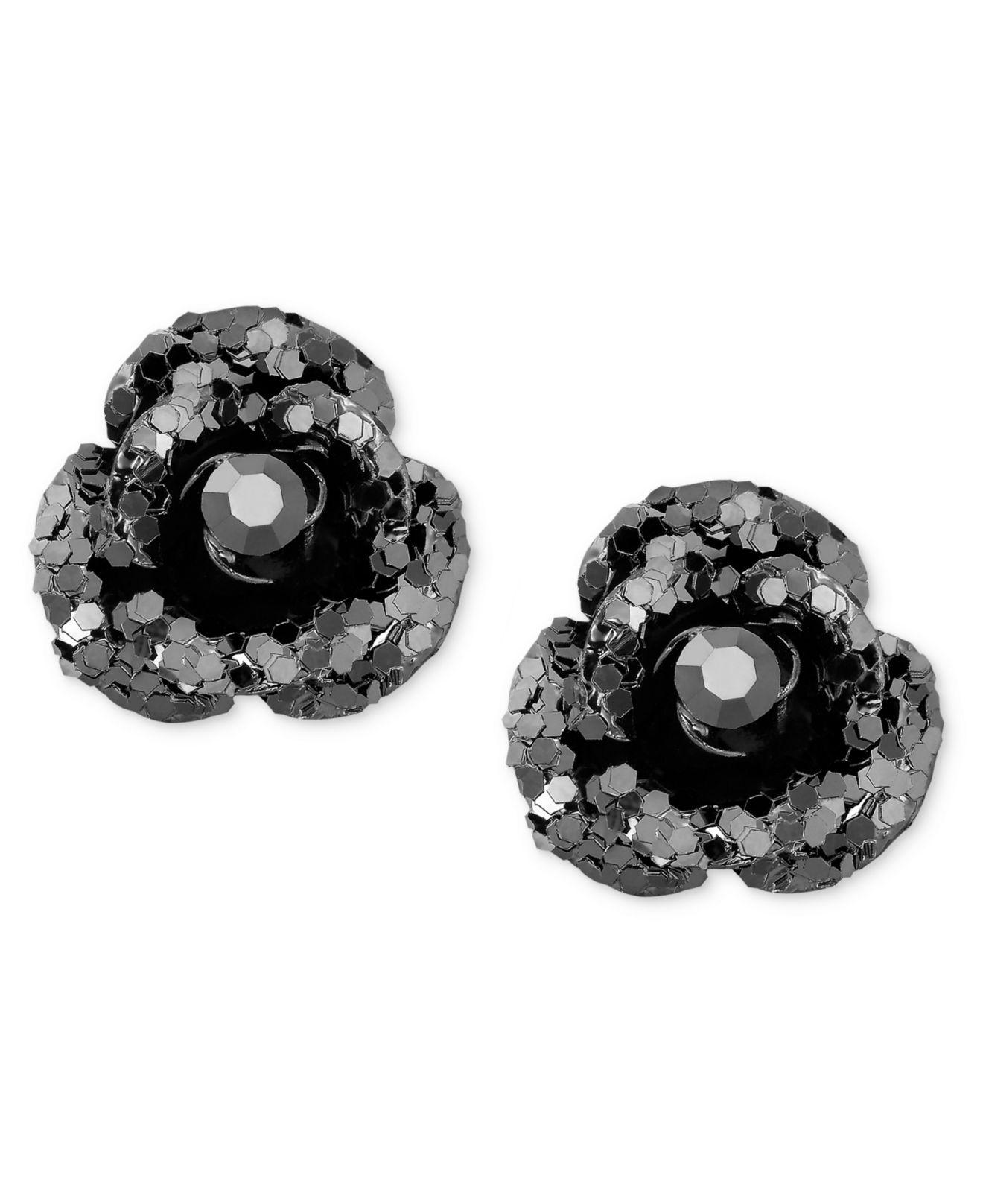 black silver and crystal tone stone pin earrings white stud