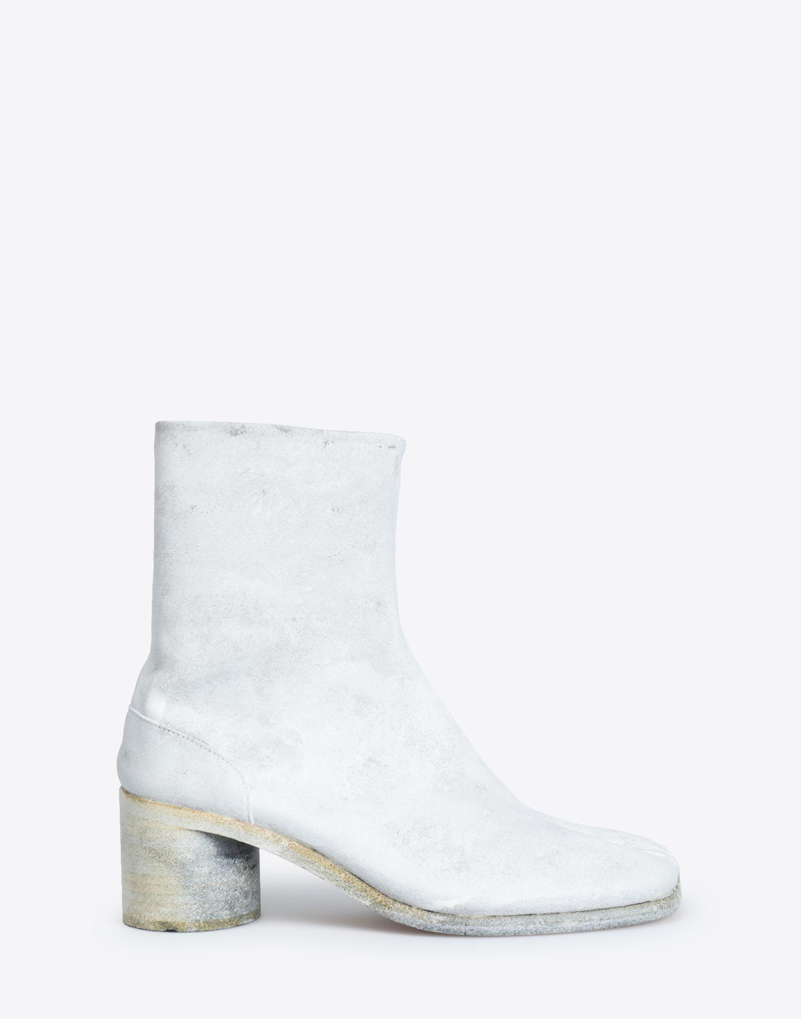 d270f57cf19ba8 ... White Painted Tabi Ankle Boots for men. Visit Maison Margiela. Tap to  visit site