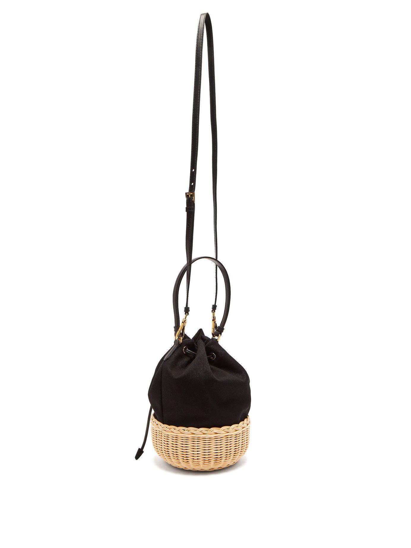 93f94466b0d2 Lyst - Prada Canvas And Woven Straw Bucket Bag in Black