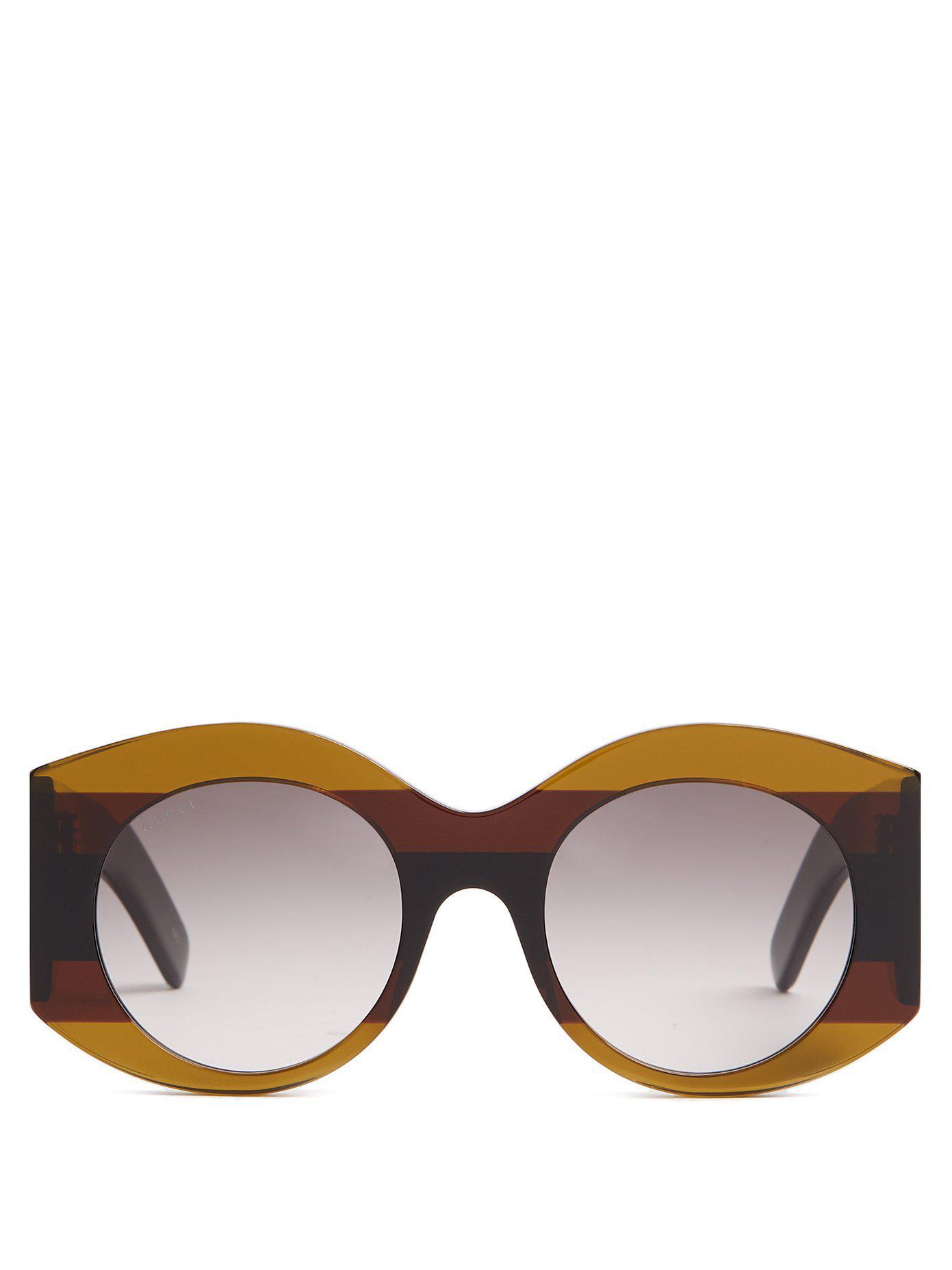 0ace5f7a626deb Lyst - Lunettes de soleil rondes en acétate à rayures Gucci