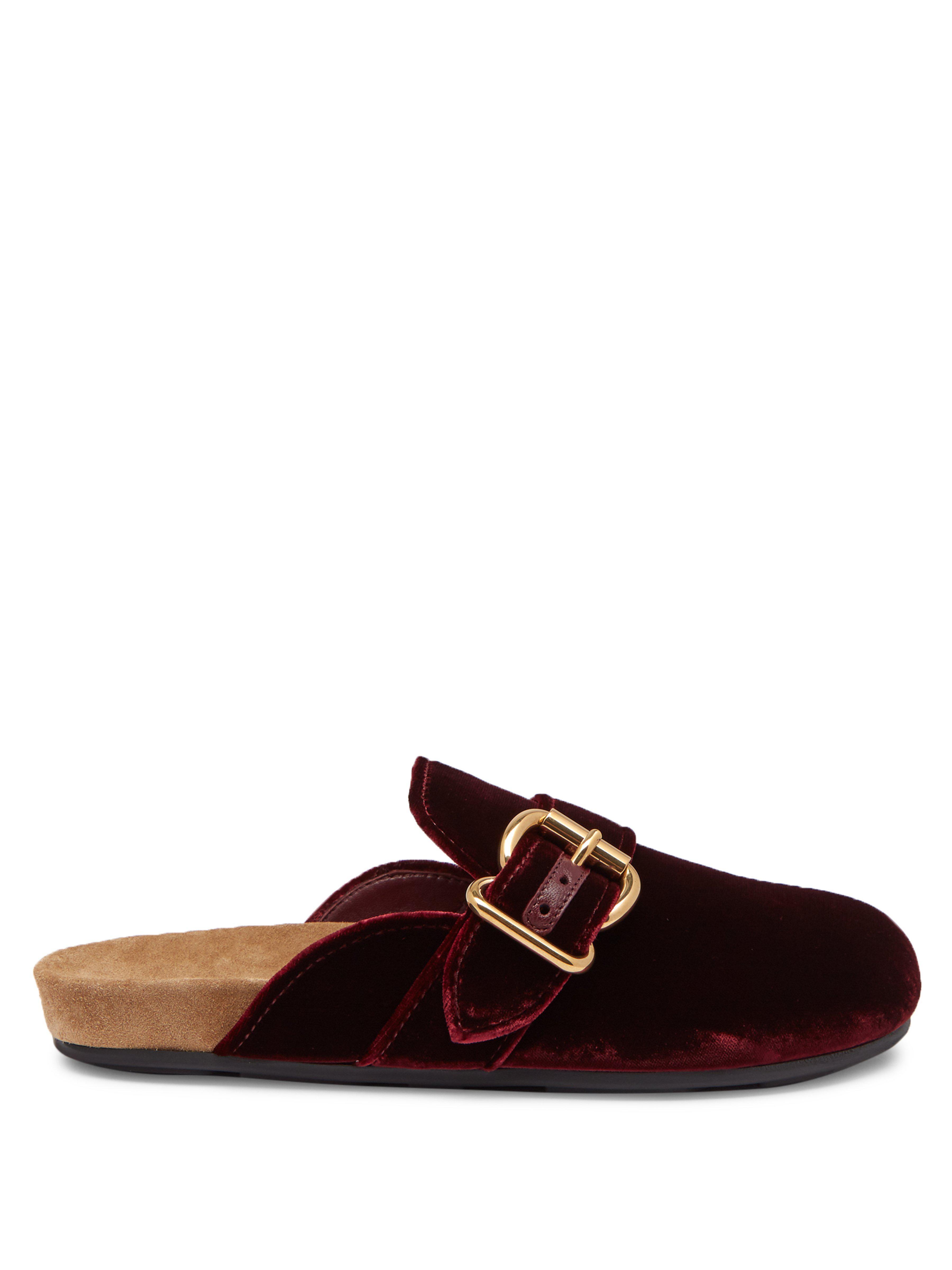 7b351da04c4 Prada. Women s Buckled Velvet Backless Loafers