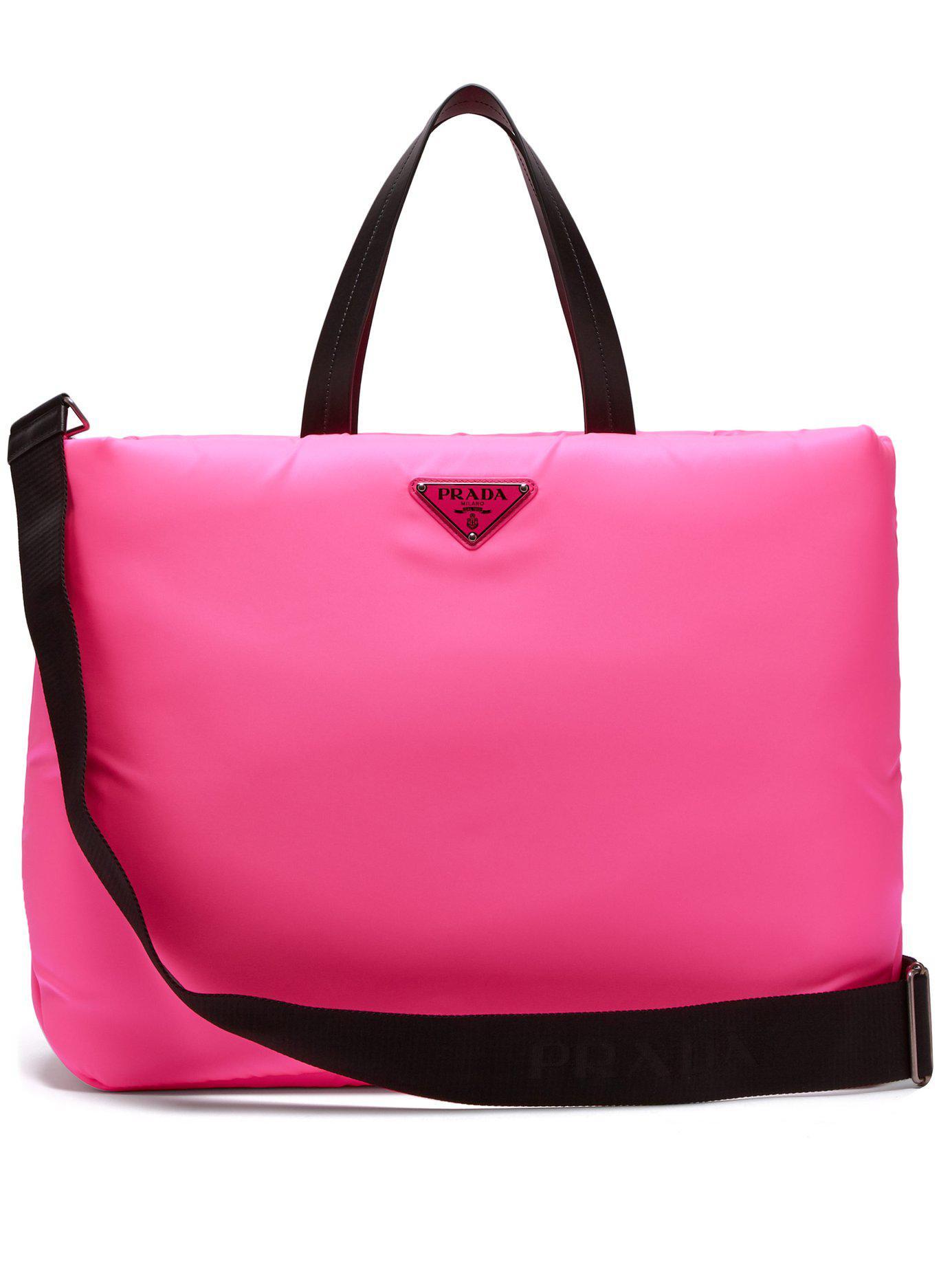 7e9f14ef4288 Lyst - Prada Logo Embellished Padded Nylon Tote Bag in Pink