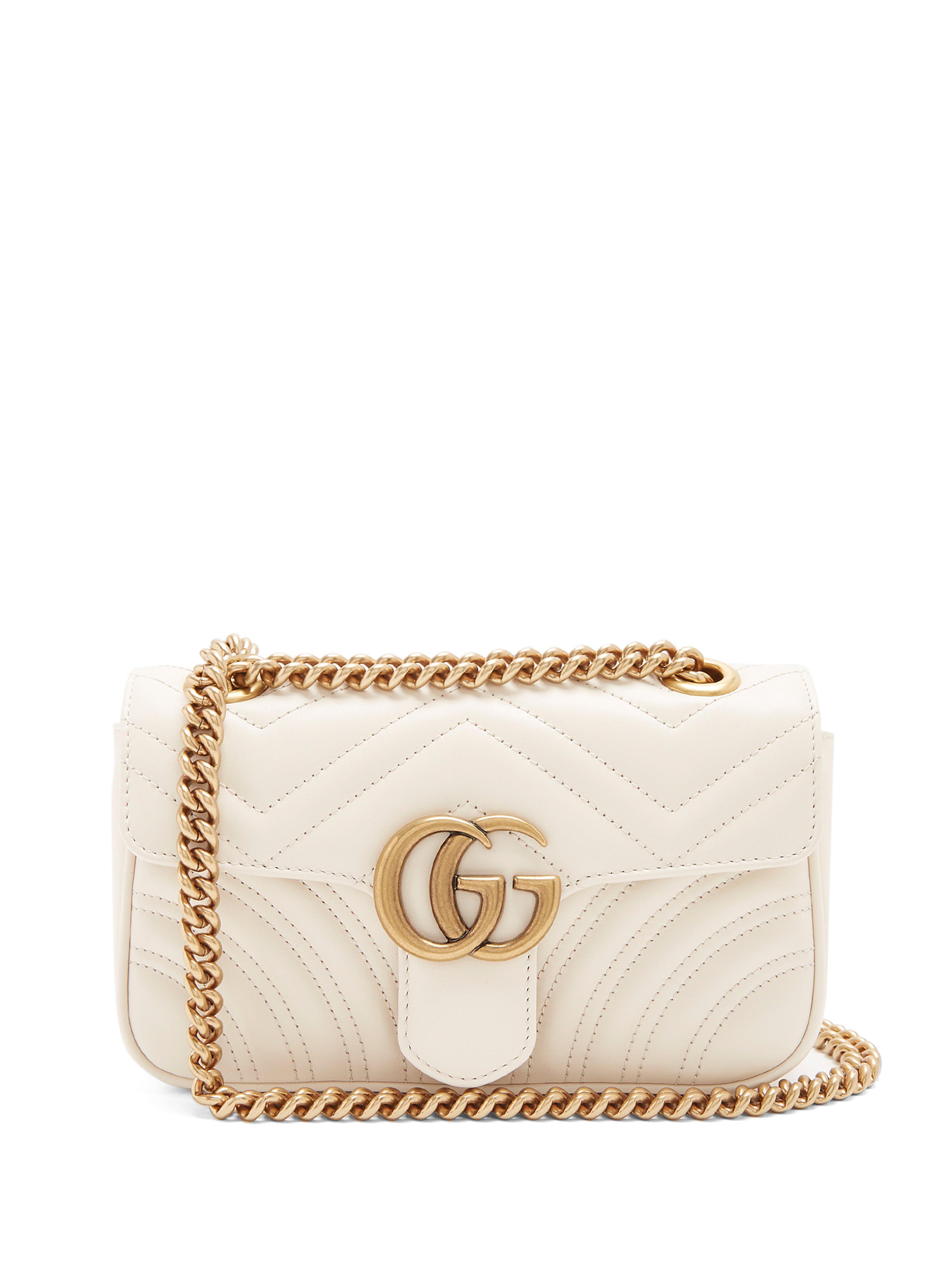 Gucci. Sac bandoulière en cuir matelassé GG Marmont mini femme de coloris  blanc cde67104543