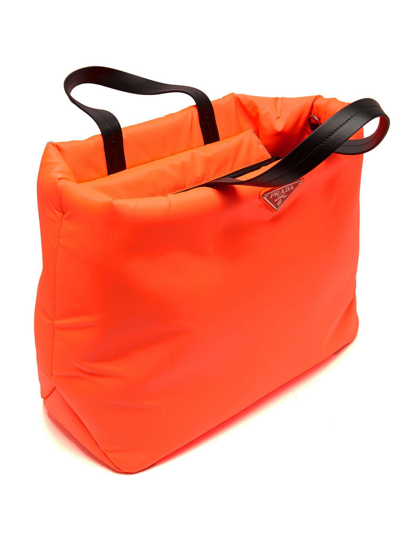 1f10c3f07055 Prada - Orange Logo Embellished Padded Nylon Tote Bag - Lyst. View  fullscreen