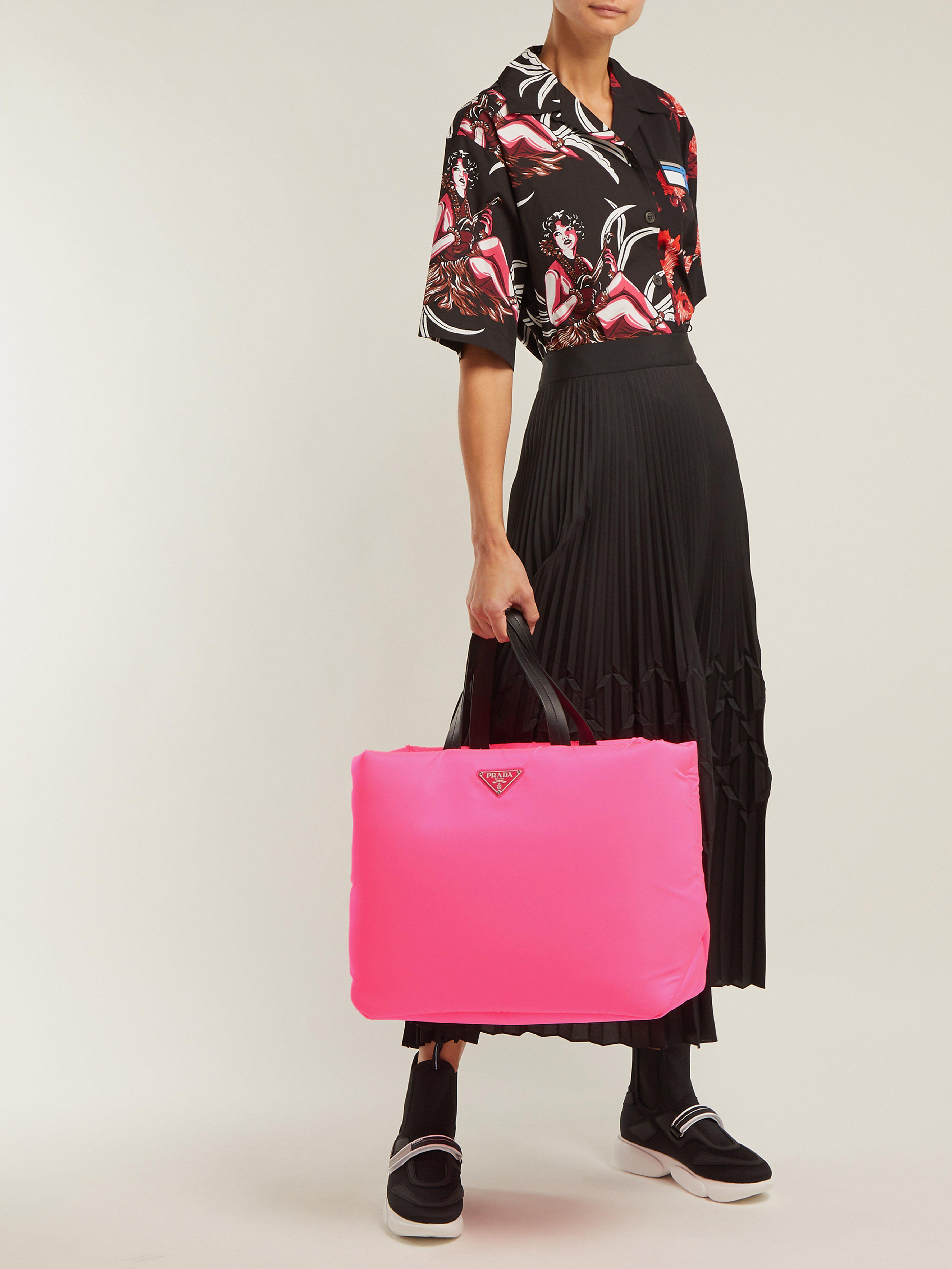 cd90c38377de Prada Logo Embellished Padded Nylon Tote Bag in Pink - Lyst