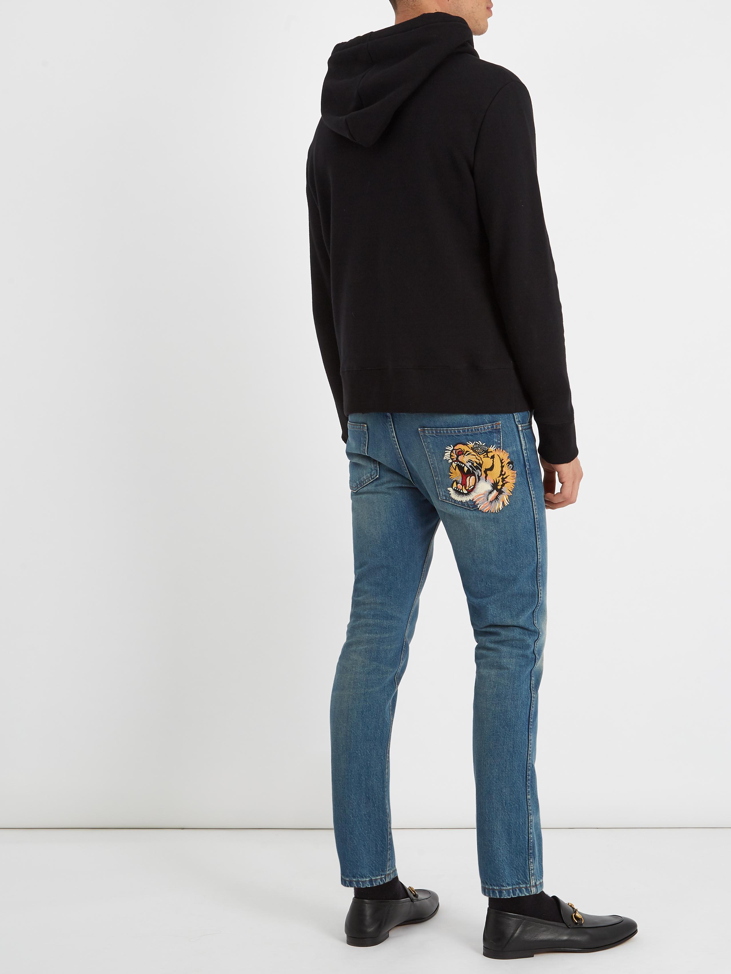 9ca923298655 Lyst - Jean fuselé taille mi-haute à broderie tigre Gucci pour homme ...