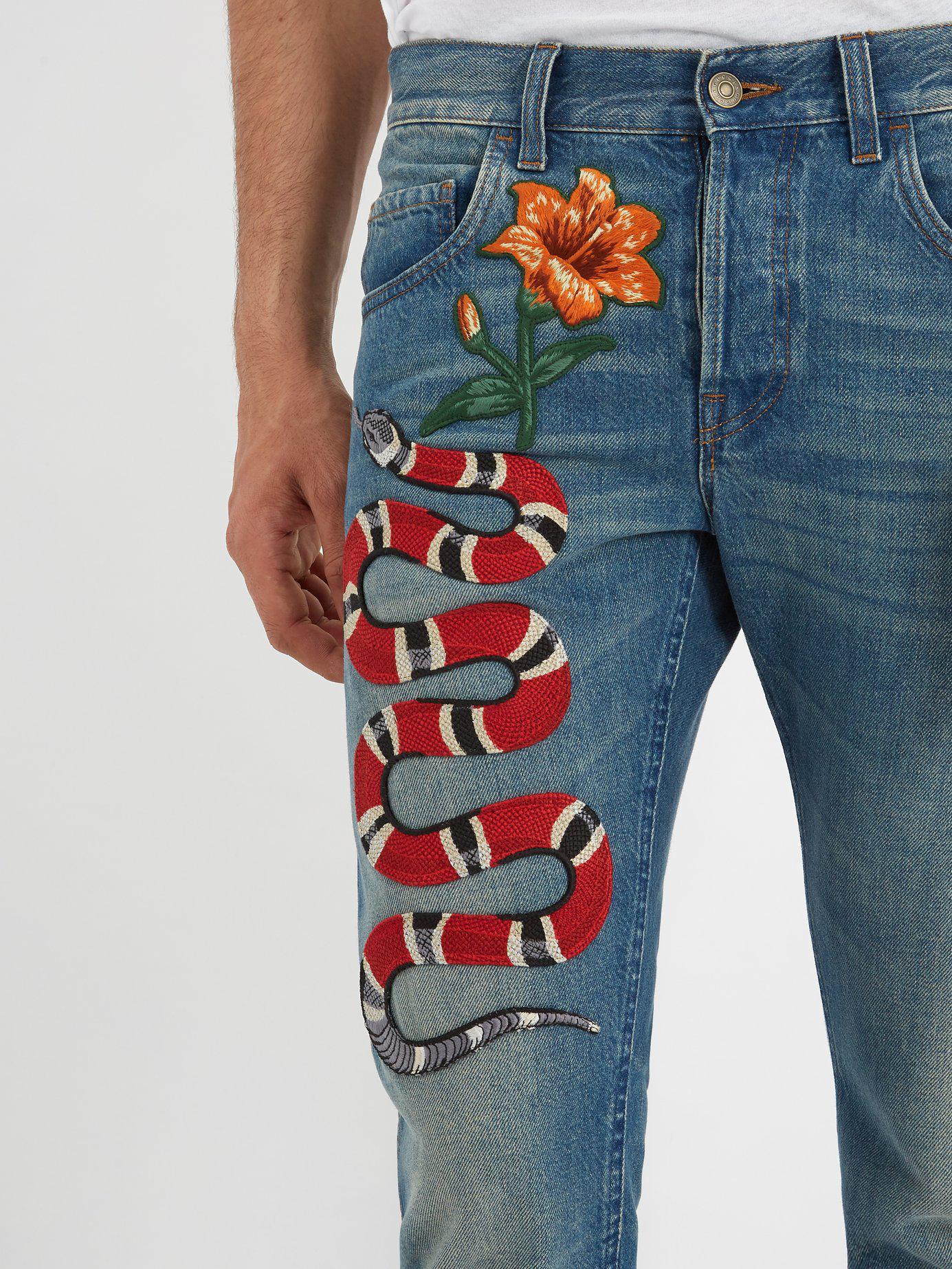 c1975928357d Lyst - Jean fuselé à broderie fleur et serpent Gucci pour homme en ...