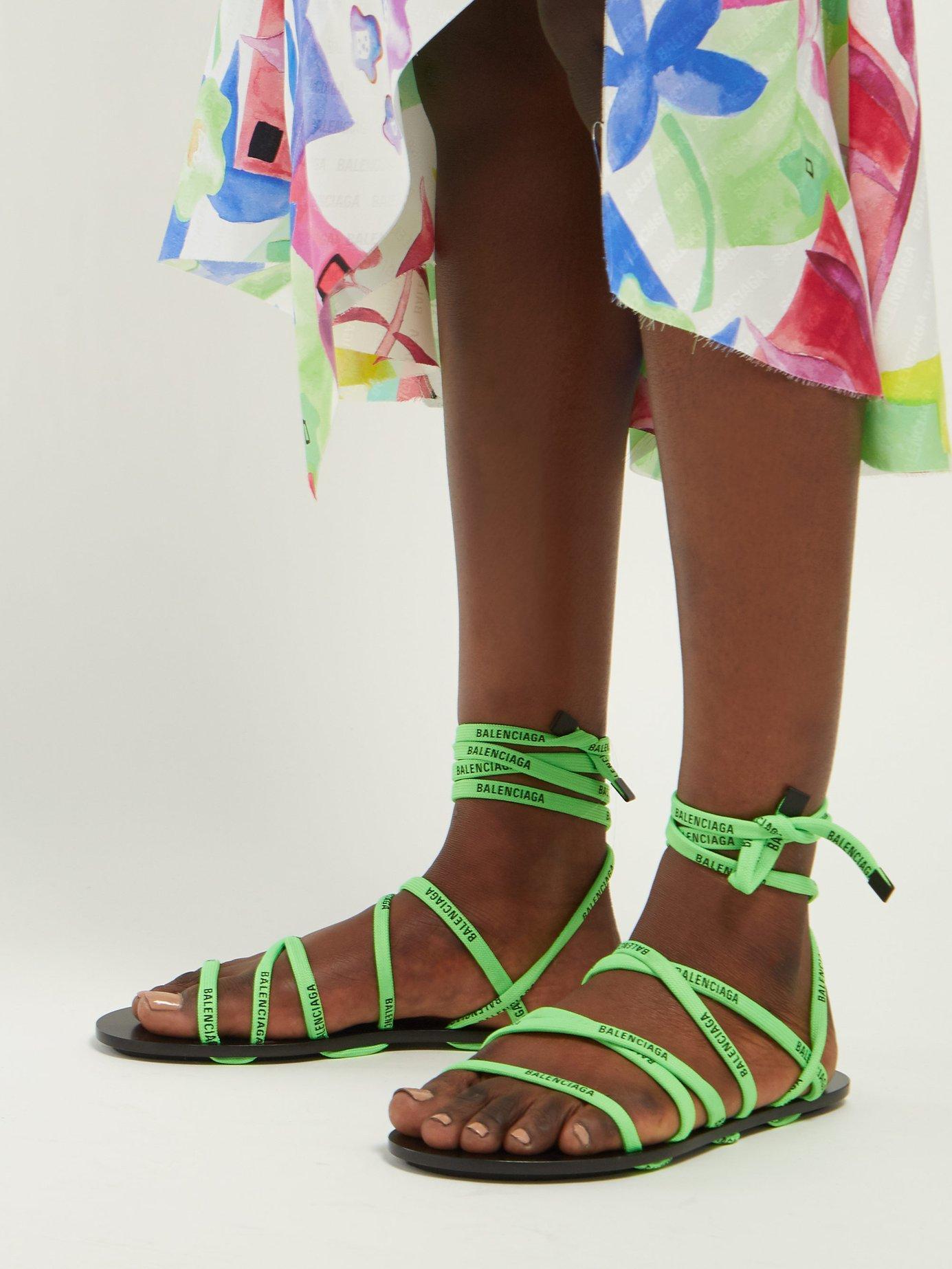 3f51cca71 Balenciaga Logo Laced Wrap Around Flat Sandals in Green - Lyst