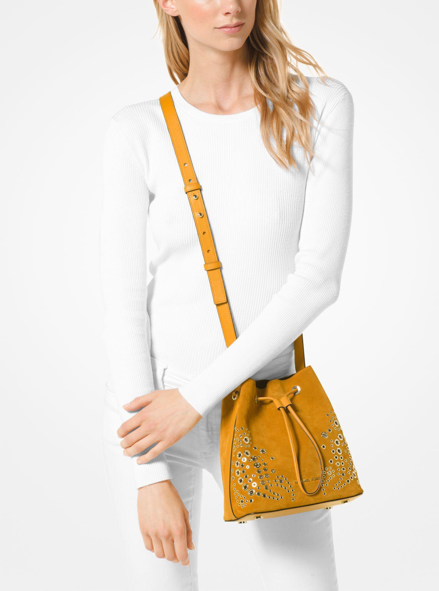 c0587f5955 Lyst - Michael Kors Cary Small Grommeted Suede Bucket Bag