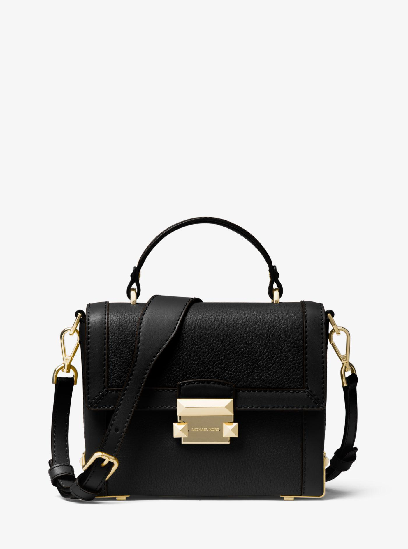 72b7ae9a65fbf ... czech michael kors jayne small pebbled leather trunk bag in black lyst  c73e5 89133