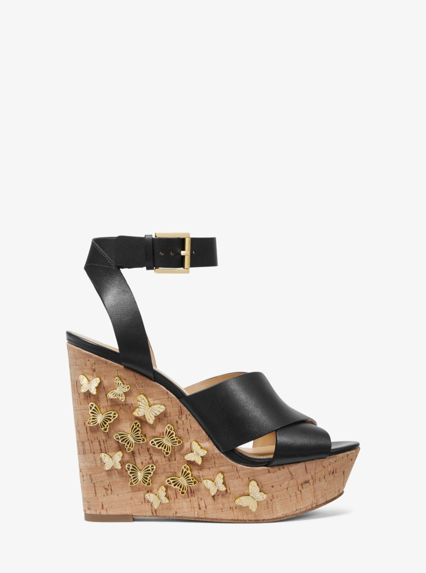 72c52b904cf Lyst - Michael Kors Lacey Butterfly Embellished Leather Wedge in Black