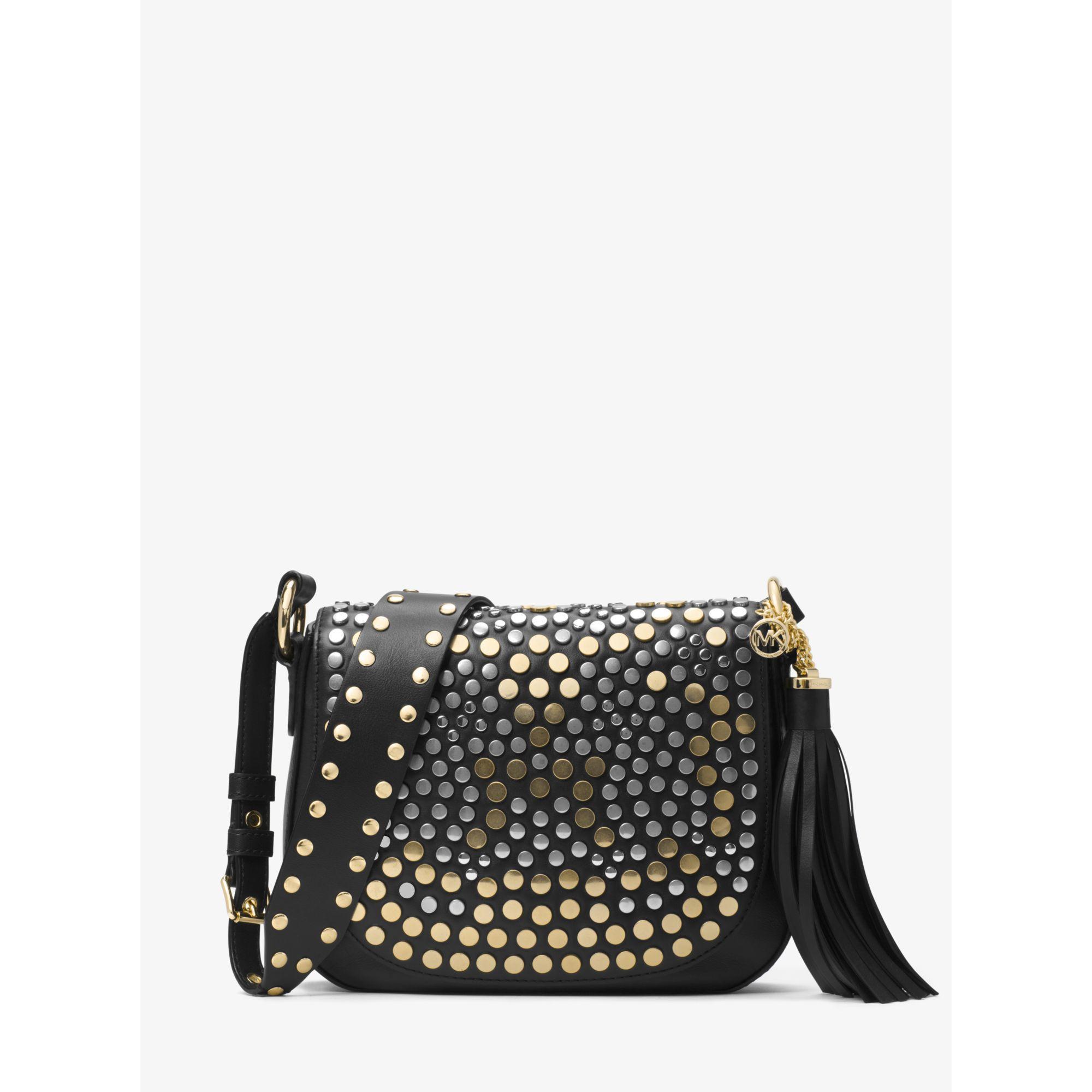 a33e83bef8d7 Lyst - Michael Kors Brooklyn Medium Studded Leather Saddle Bag in Black