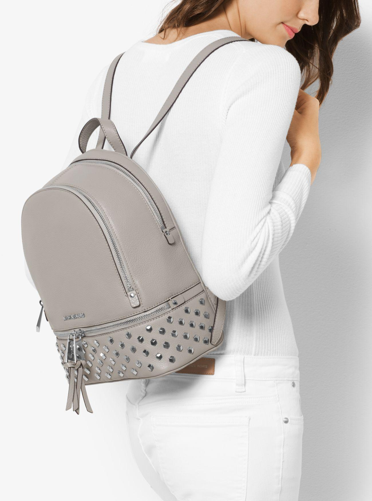27d2ae27f48f8 Lyst - Michael Kors Rhea Medium Studded Leather Backpack in Gray