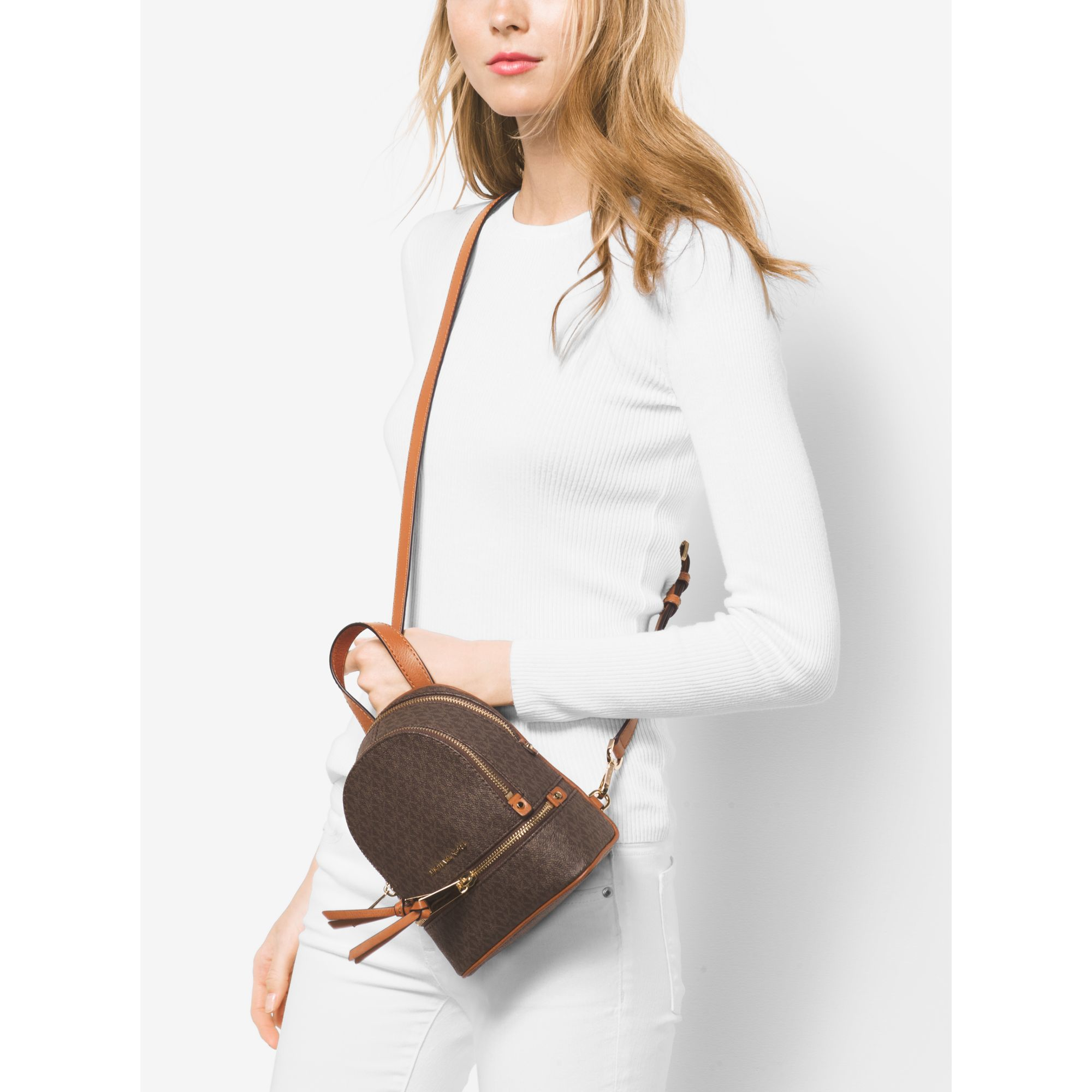 eae61f25716f Michael Kors Rhea Extra-small Logo Backpack in Brown - Lyst