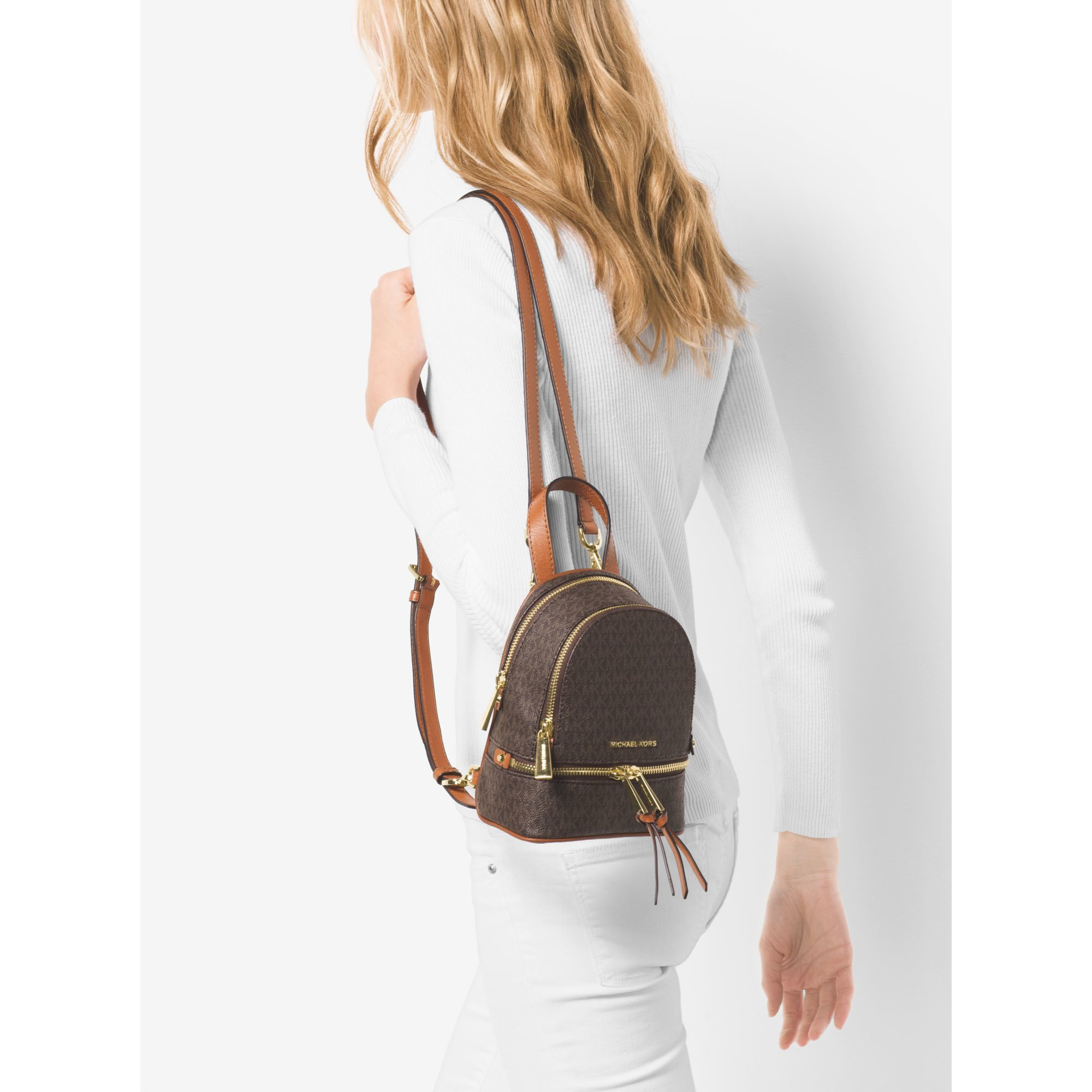 a812d9708c91 Lyst - Michael Kors Rhea Extra-small Logo Backpack in Brown