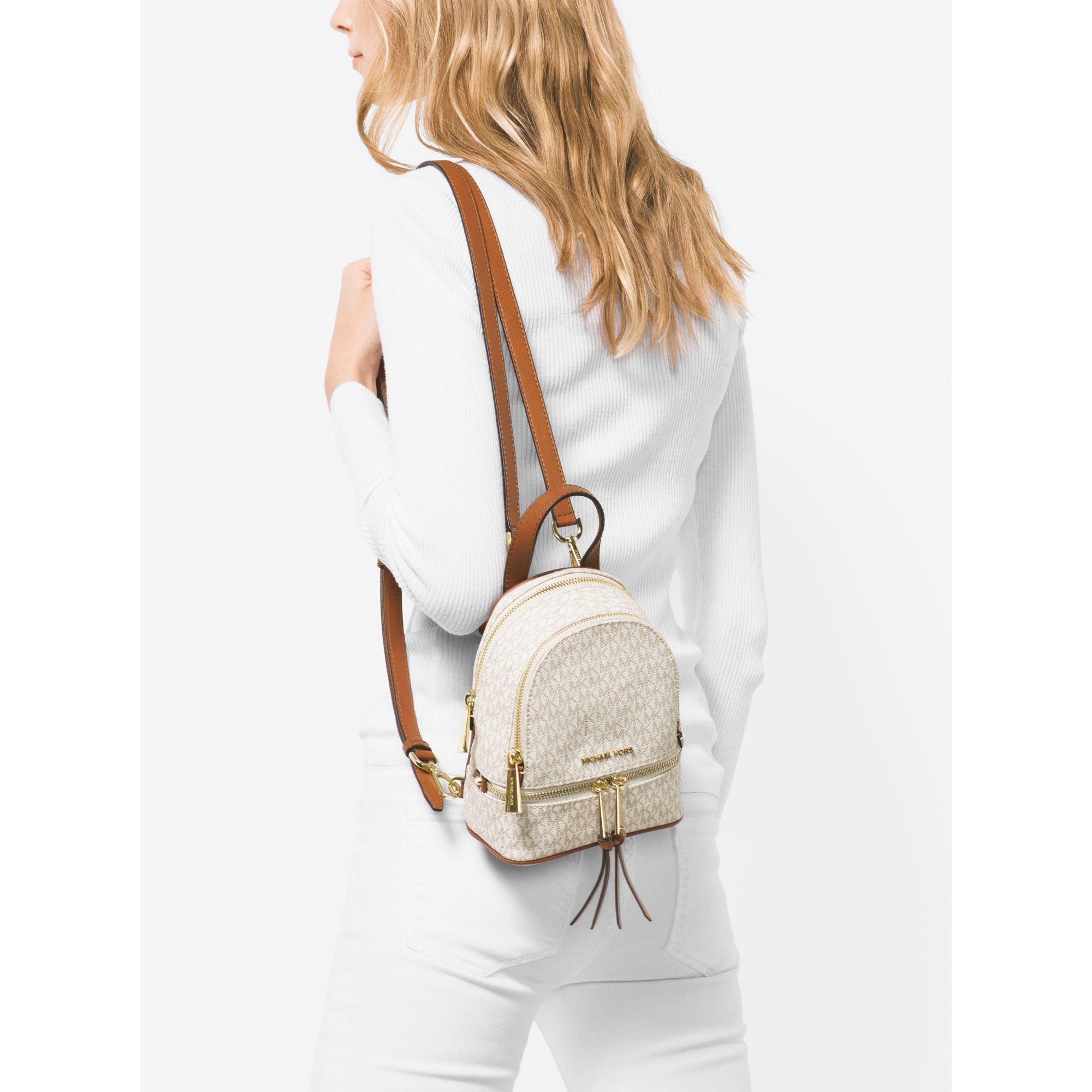 cb6494878c sale michael kors pink rhea extra small leather backpack lyst bed0c f9b85