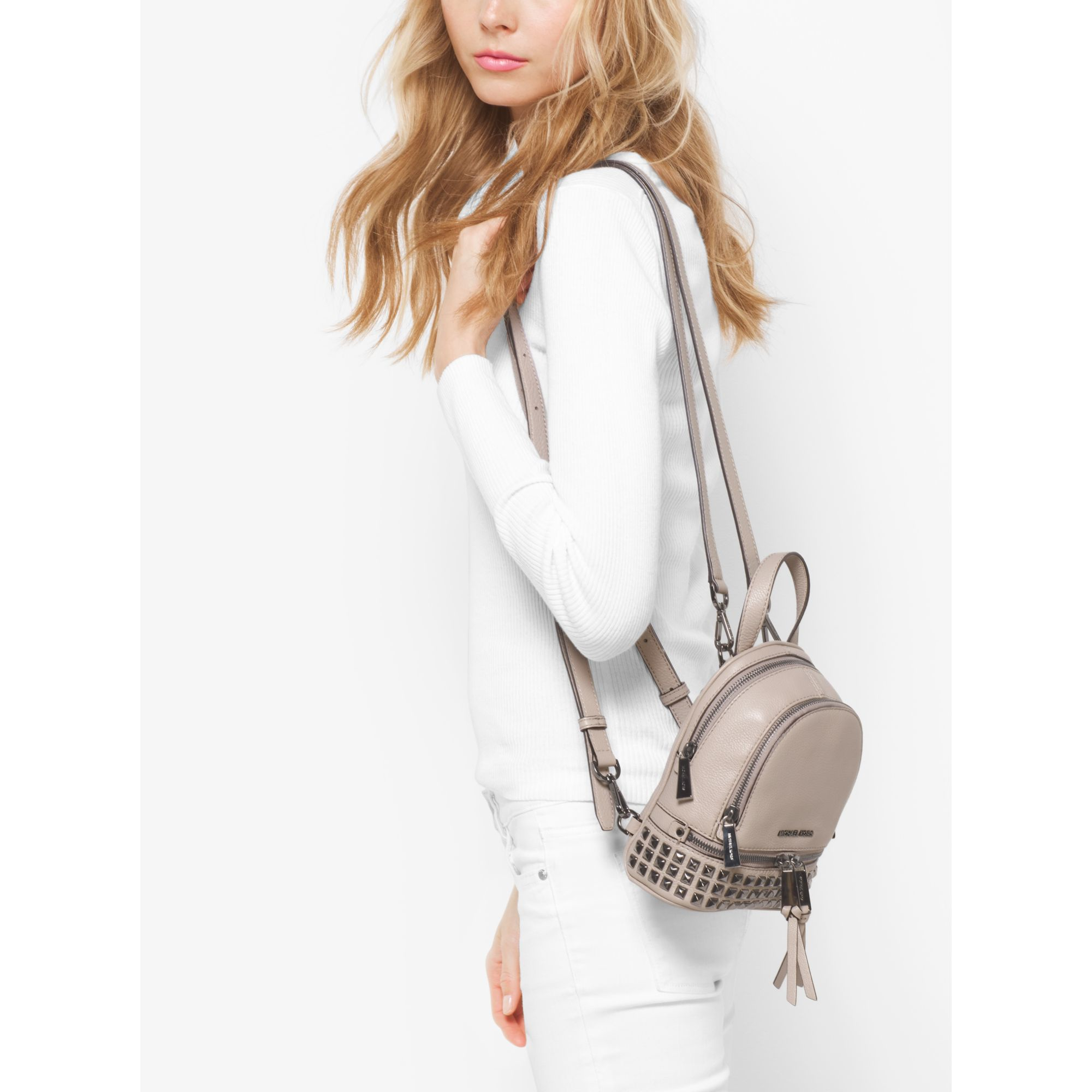 145662fd1528 ... good lyst michael kors rhea extra small studded leather backpack in  gray 49748 81629