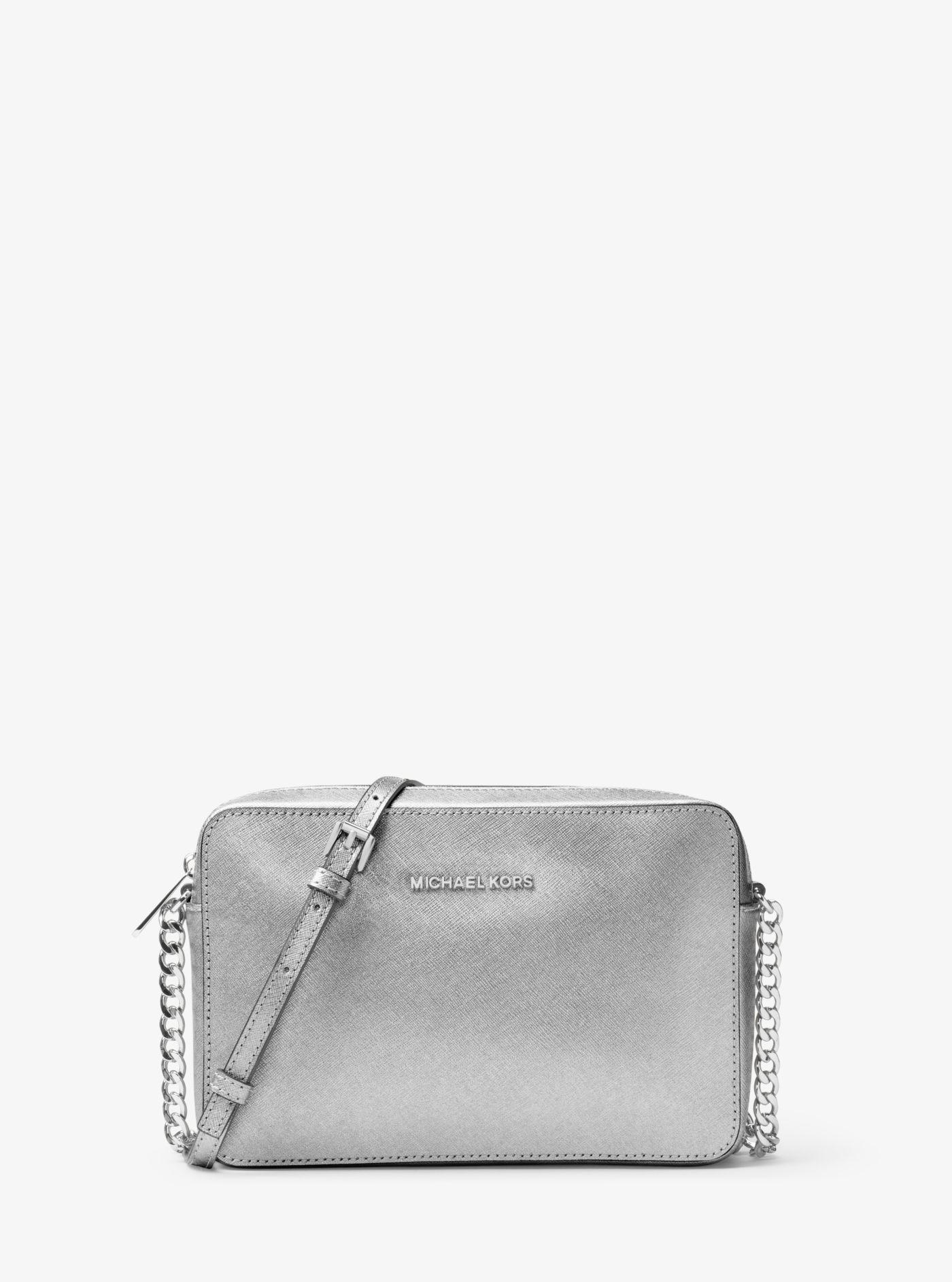 1868b942da Michael Kors - Jet Set Travel Large Metallic Leather Crossbody - Lyst. View  fullscreen