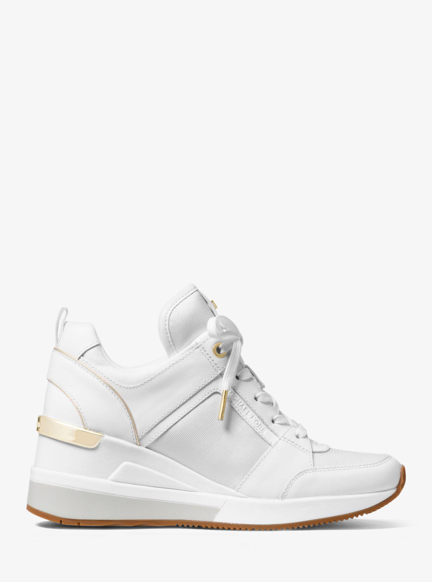 958c6c83ed2 Michael Kors Georgie Canvas And Leather Sneaker in White - Lyst