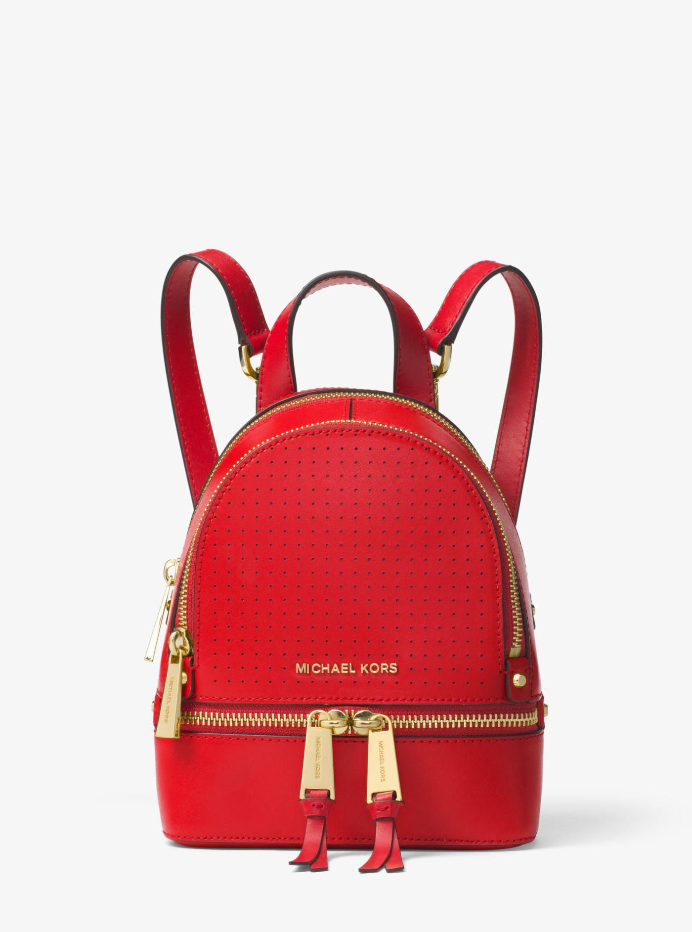 d5129baf05ab Lyst - Michael Kors Rhea Large Leather Backpack in Red