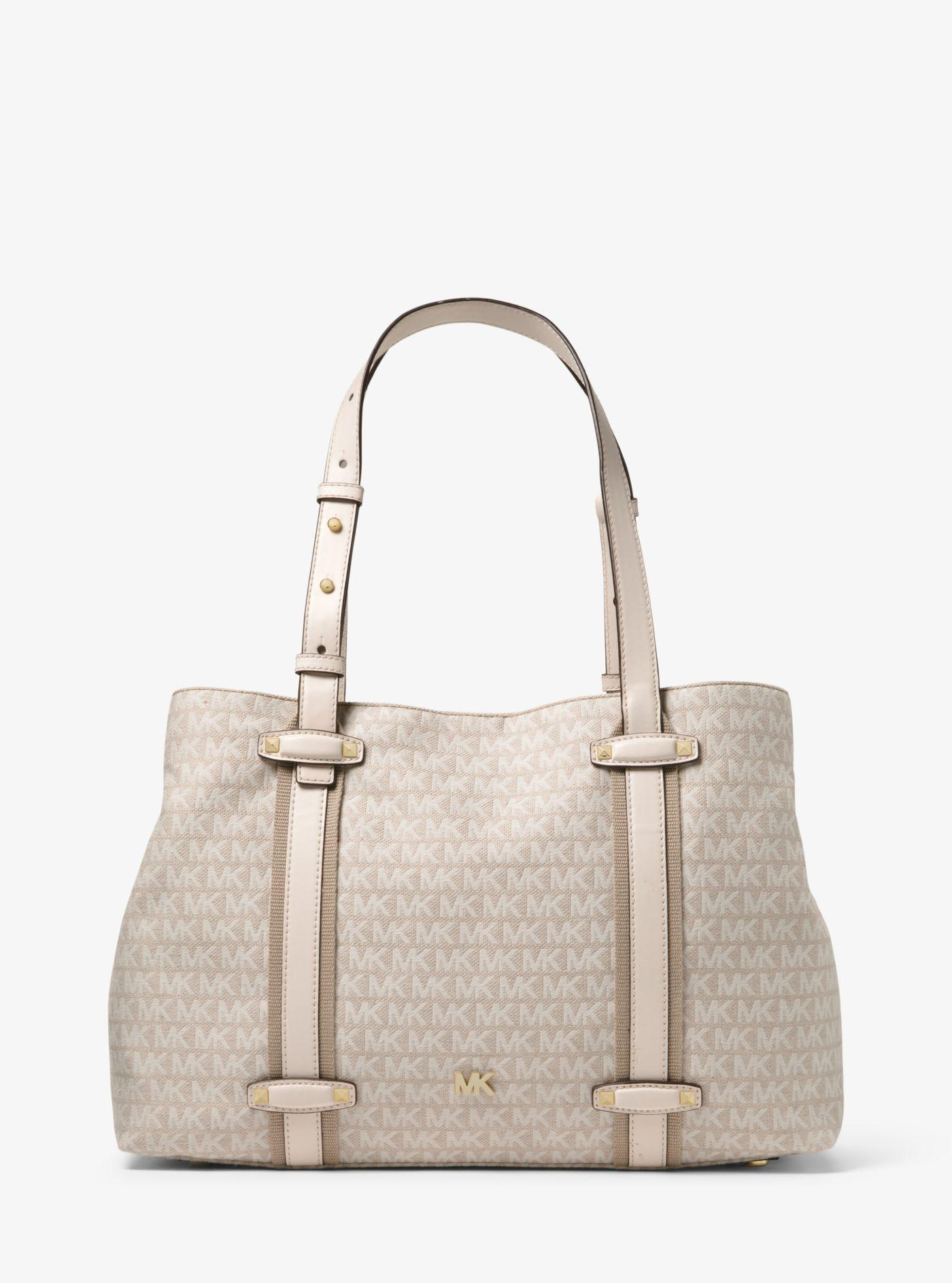 4a7a0fea4db8 ... sweden michael kors griffin large logo jacquard tote in natural lyst  3b9b0 6e088