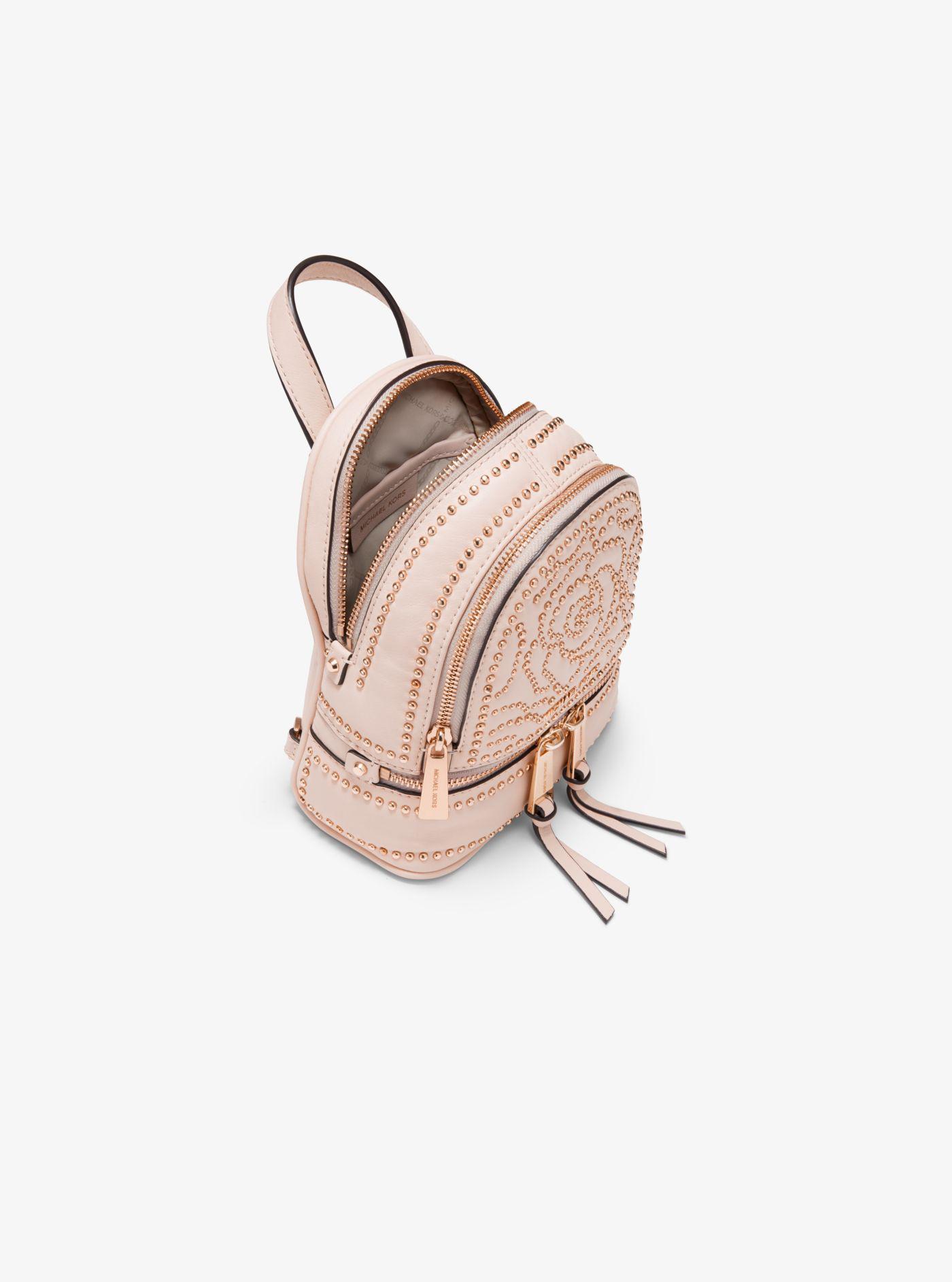 b9691b586f21 Michael Kors - Pink Rhea Mini Rose Studded Leather Backpack - Lyst. View  fullscreen