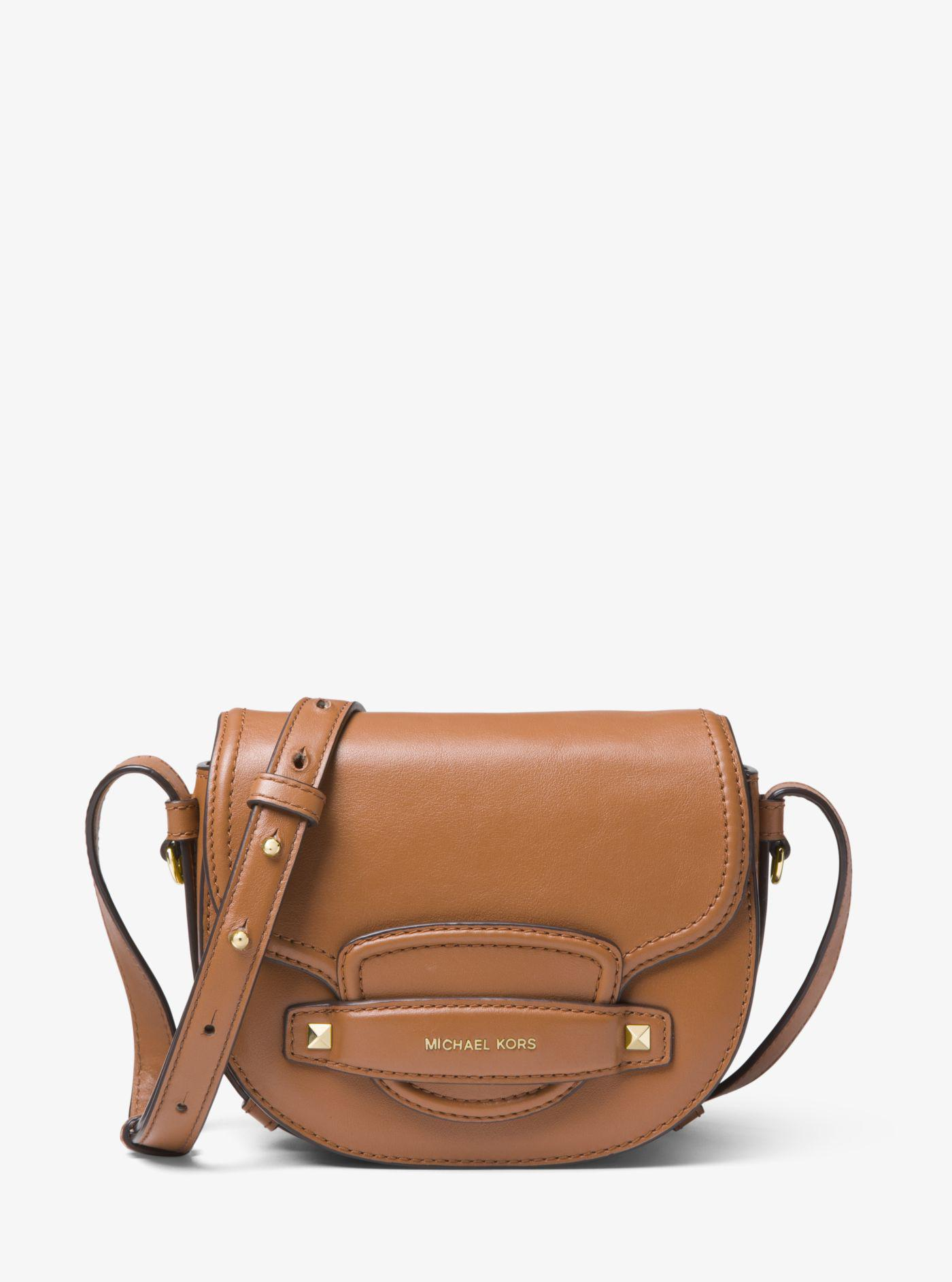 7ad5df8cdb7 Lyst - Michael Kors Cary Small Leather Saddle Bag in Brown