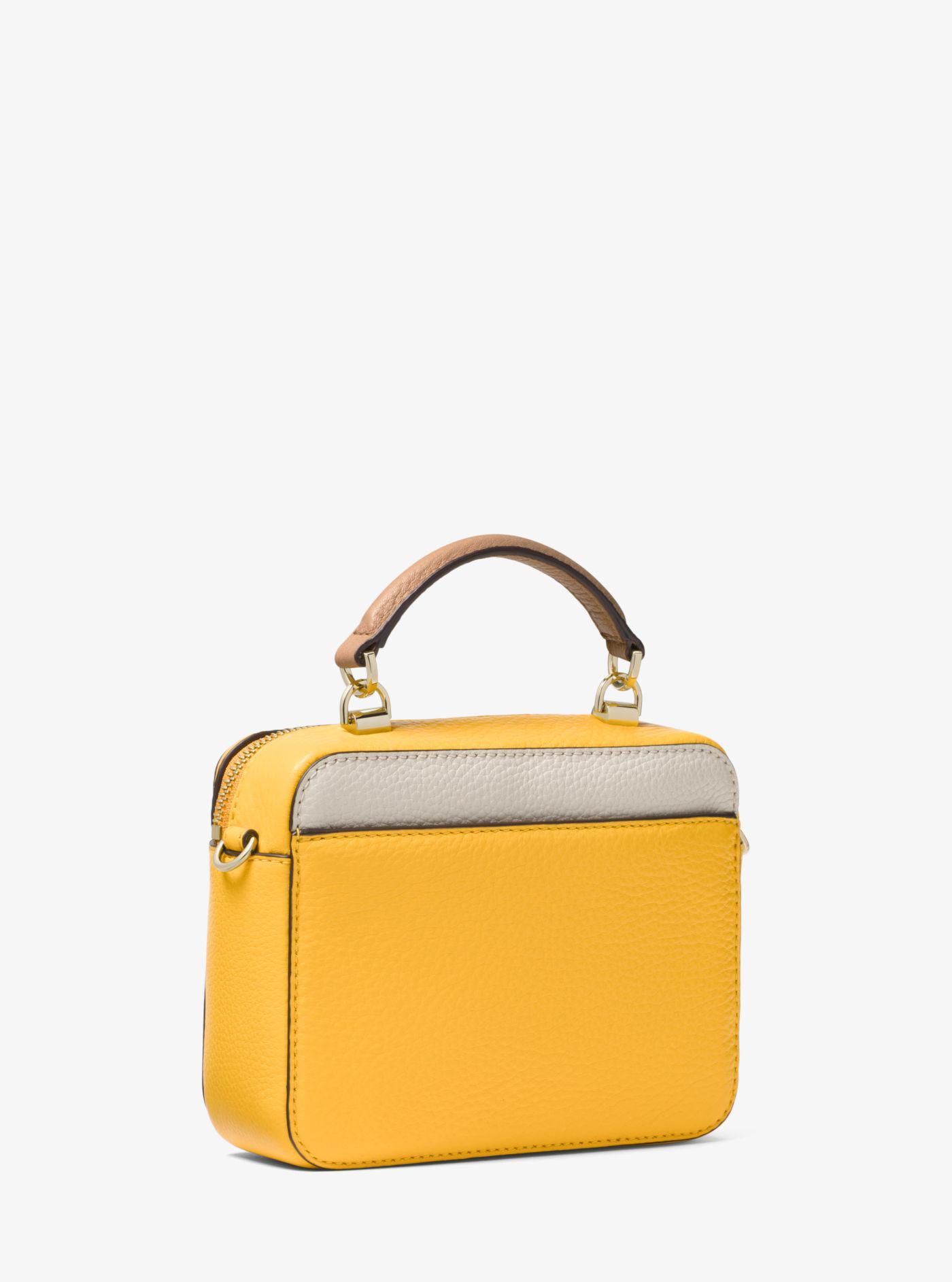 e9f9143a2921 Lyst - Michael Kors Mott Mini Color-block Pebbled Leather Crossbody Bag