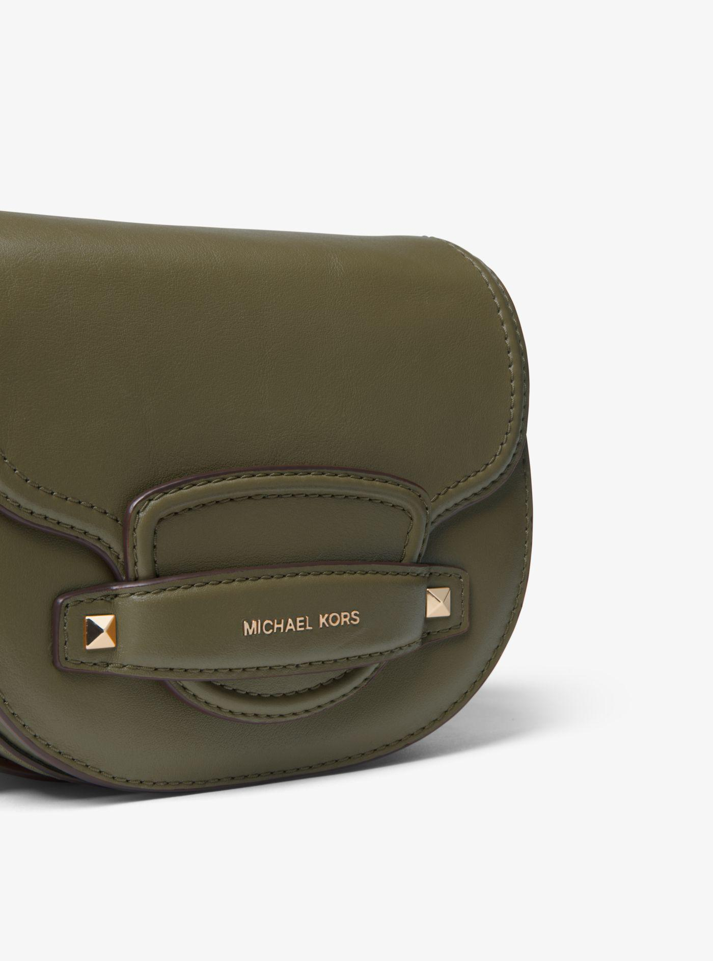 f3105bce3852 Lyst - Michael Kors Cary Small Leather Saddle Bag in Green