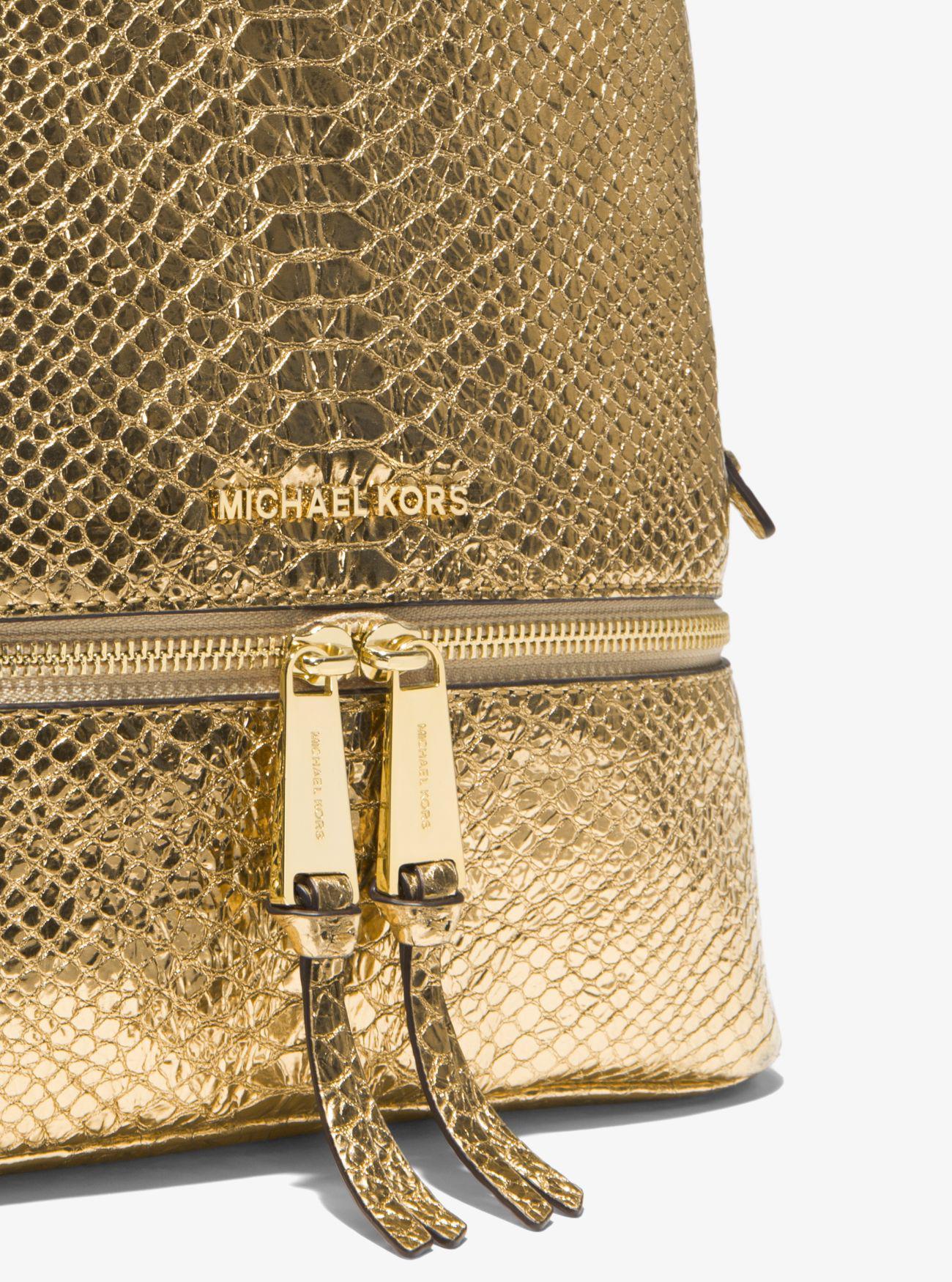 db0405fcc0 Lyst - Michael Kors Rhea Medium Metallic Embossed-leather Backpack ...