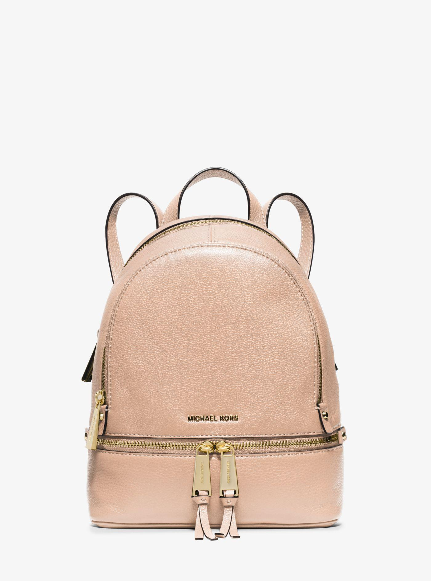 70a8390f54f7 ... cheap lyst michael kors rhea extra small leather backpack in pink a159c  08869