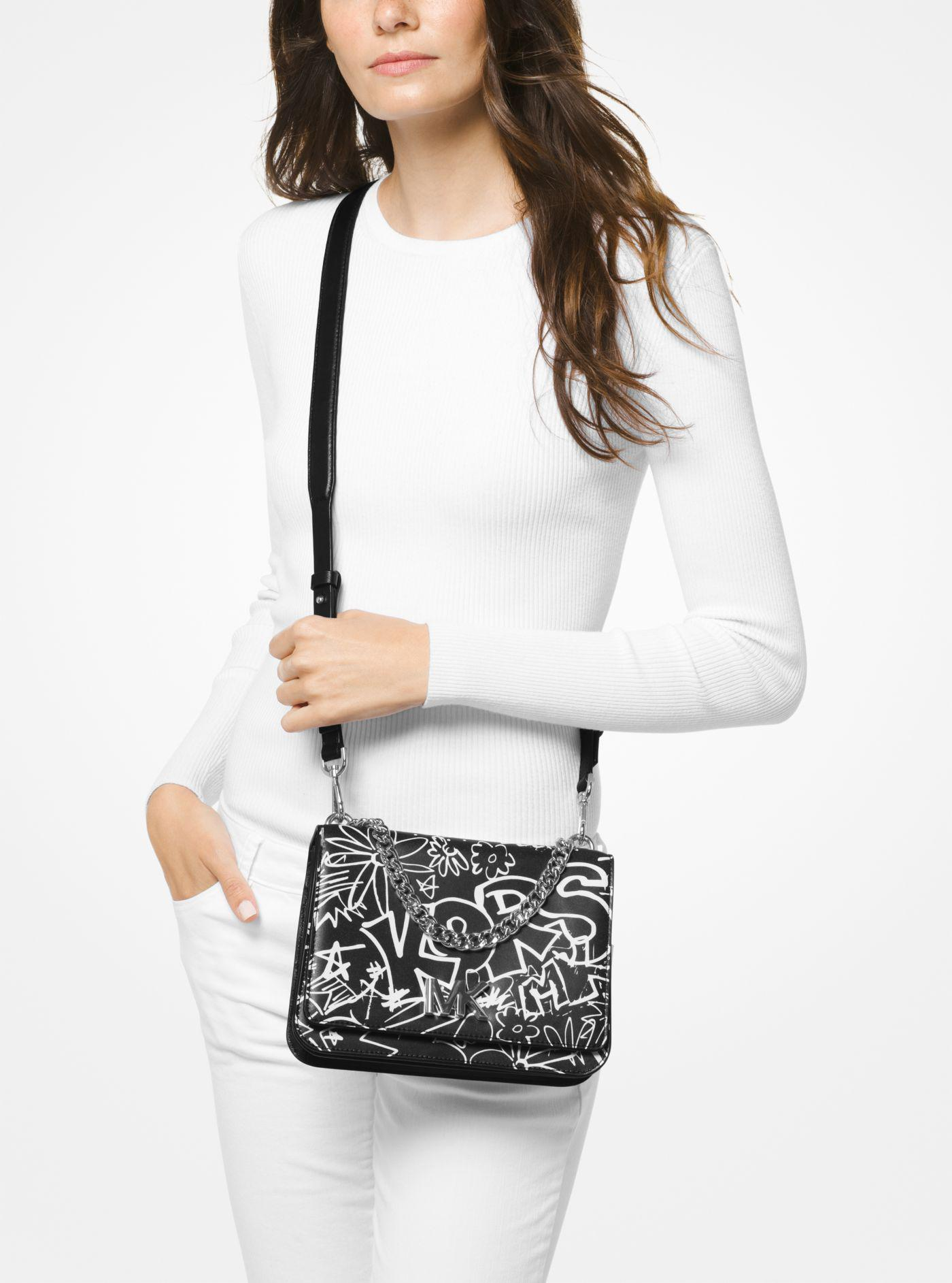 b2fab92626cd Michael Kors Mott Large Graffiti Leather Crossbody in Black - Lyst