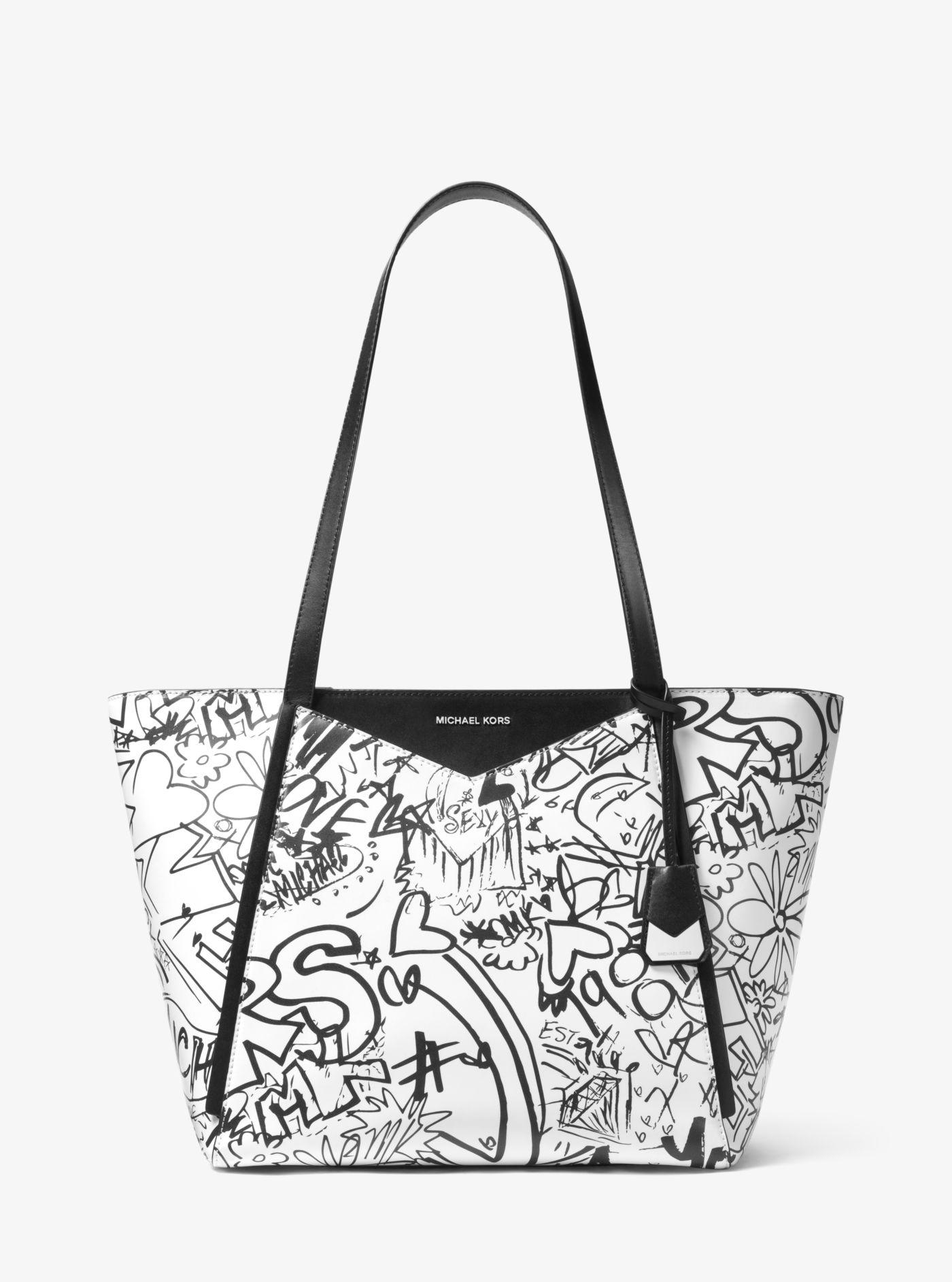 2e81fa577b56 ... discount michael kors multicolor whitney large graffiti leather tote  lyst. view fullscreen 96b14 d978b