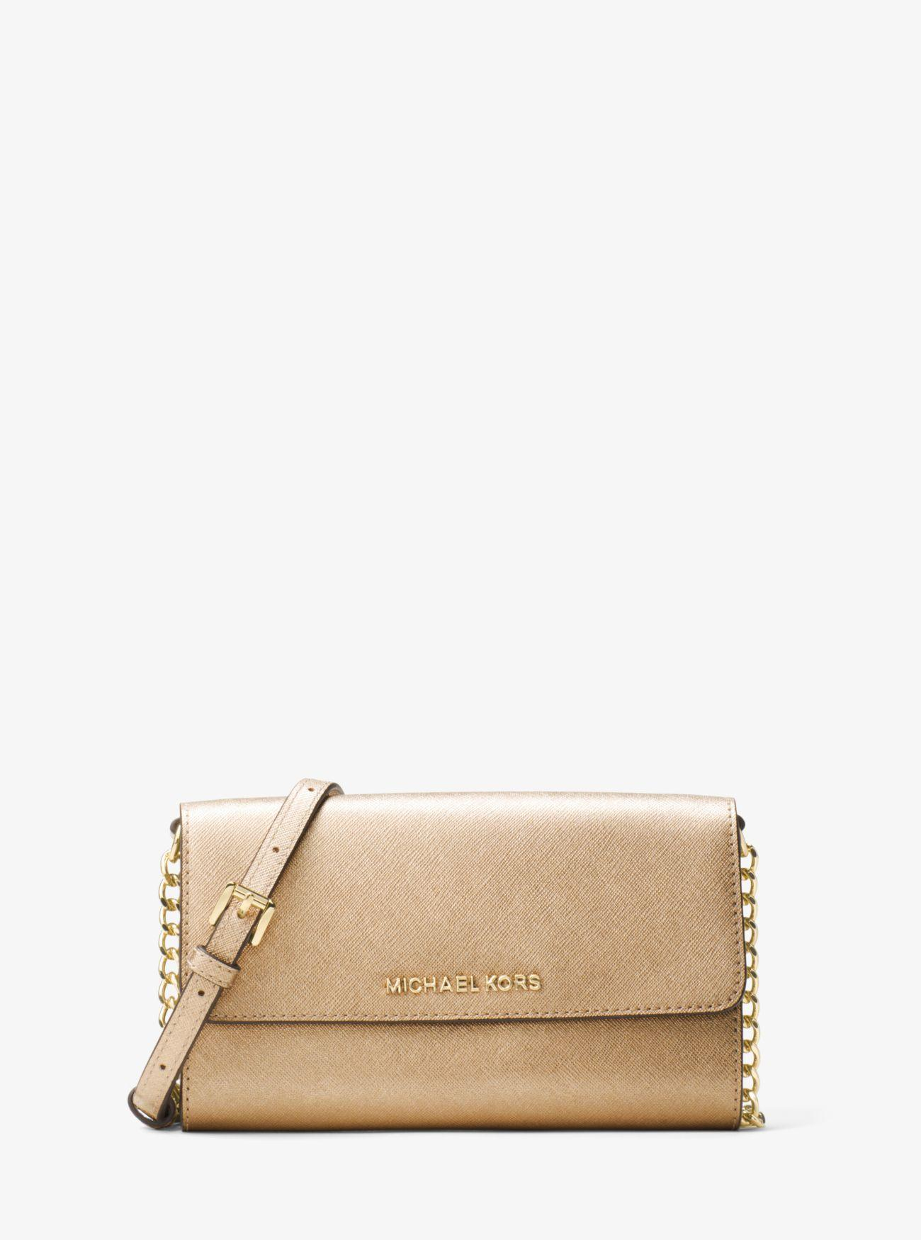 0459abeac20d81 Michael Kors - Jet Set Travel Metallic Leather Smartphone Crossbody - Lyst.  View fullscreen