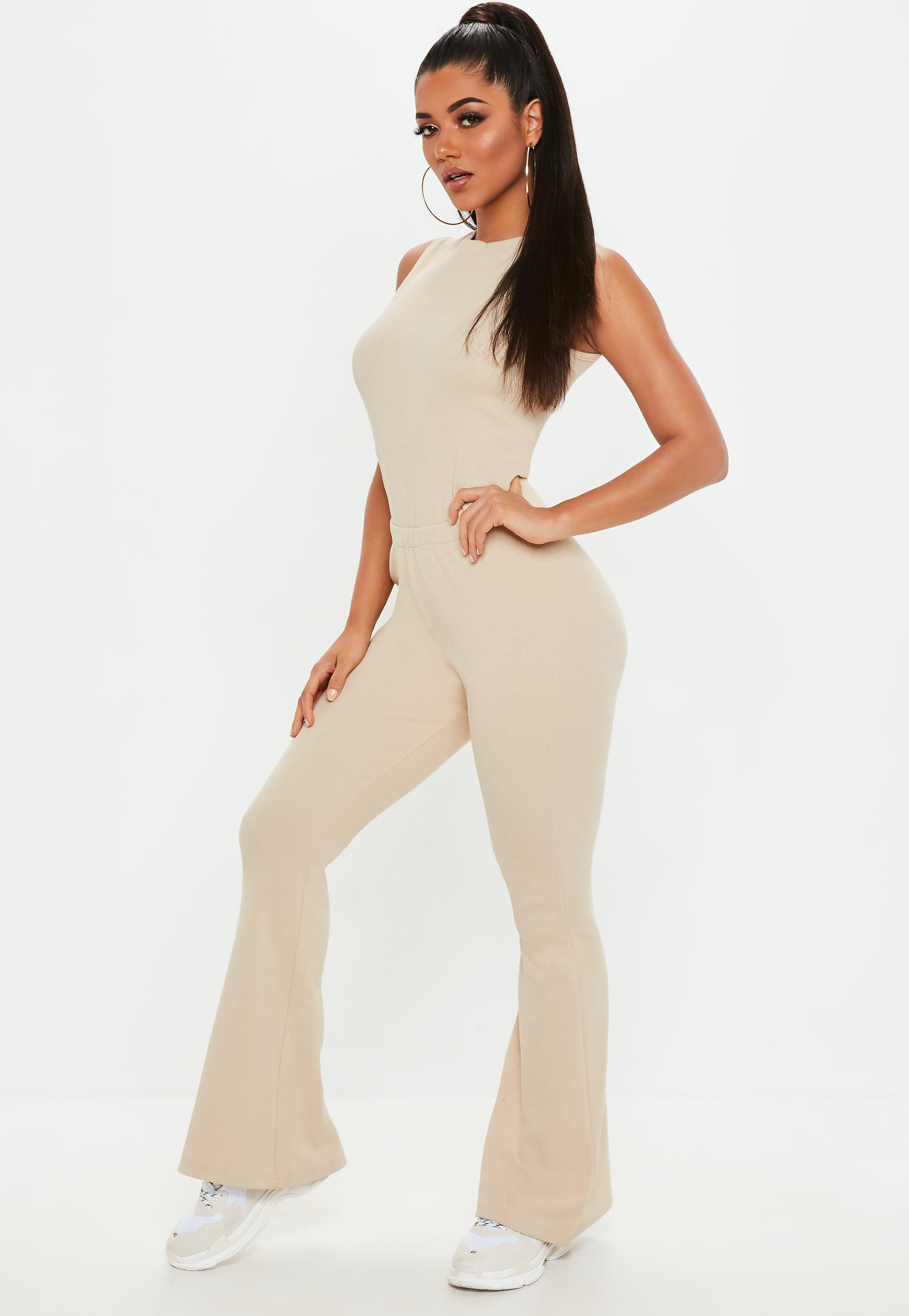 fd3b8680885b Missguided - Natural Nude Ribbed Flared Jumpsuit - Lyst. View fullscreen