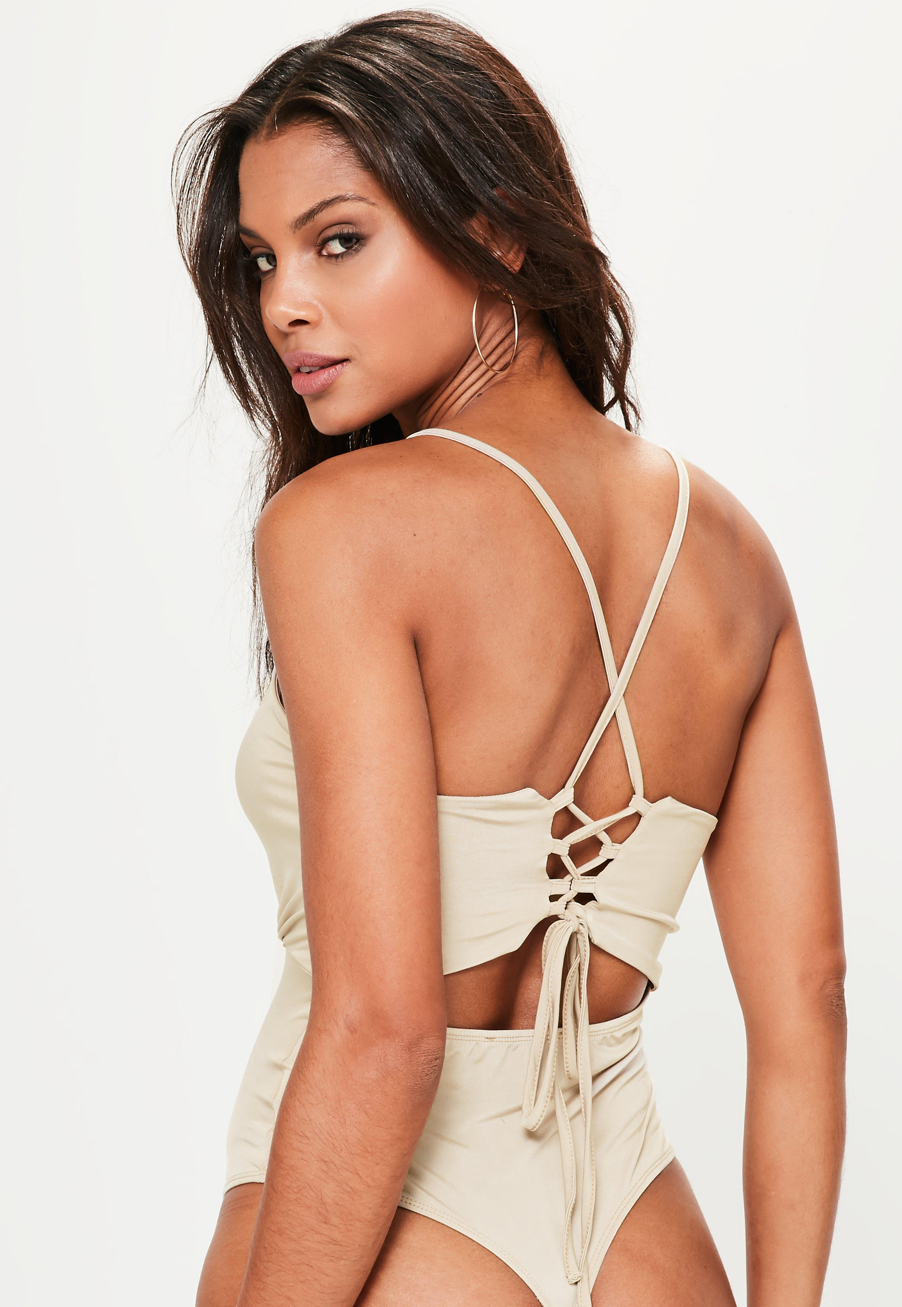 Lyst - Missguided Nude Deep Plunge Strap Back Bodysuit in Natural 5d0a70ce6